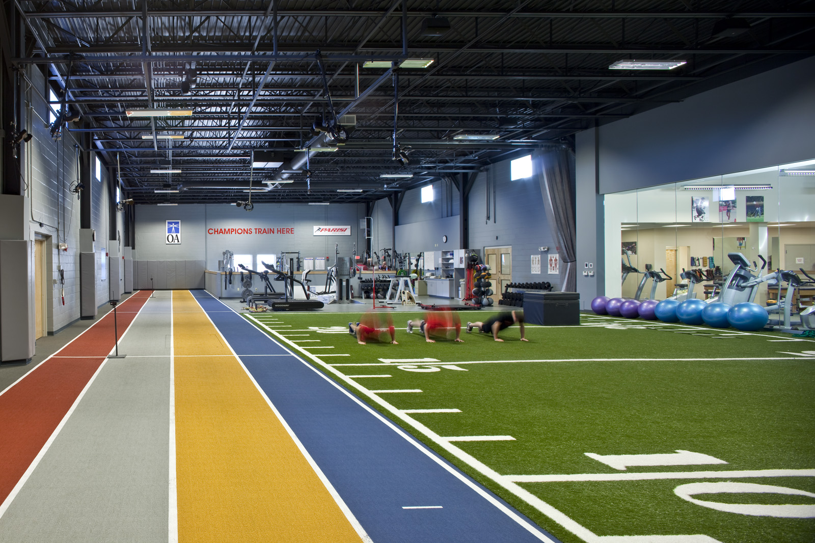 The Performance Center and Parisi Speed School includes a 4-lane, 50-yard track, a weight room, and a turf field.