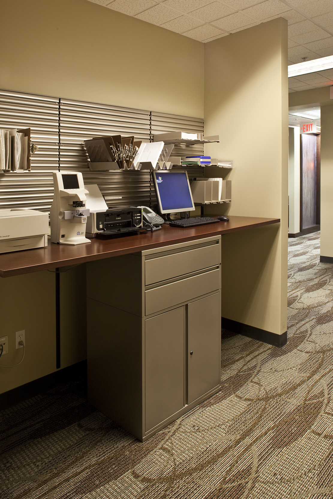 Providers stand at innovative hallway workstations to type notes, do paperwork, and check charts.
