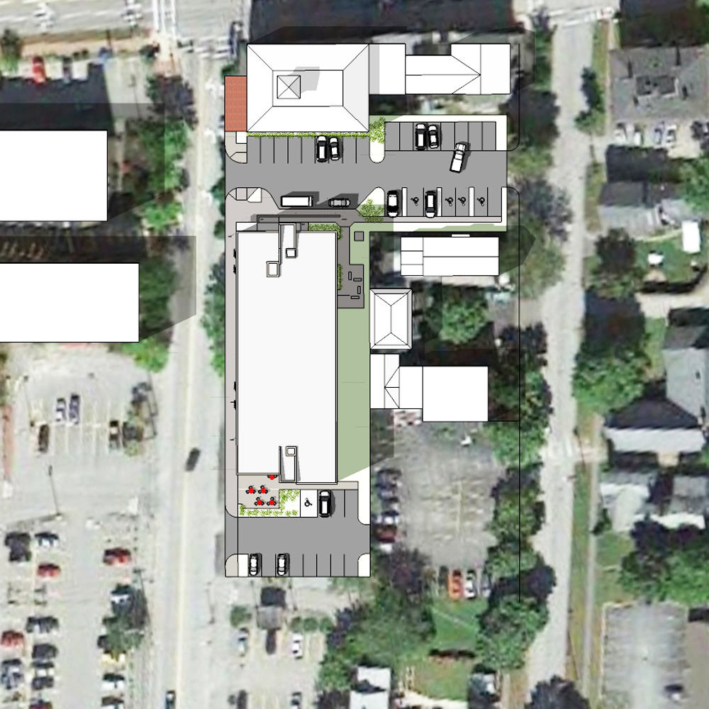 Site planning creates a courtyard with drop-offs at either end of the entry plaza and on-site parking adjacent to the building.
