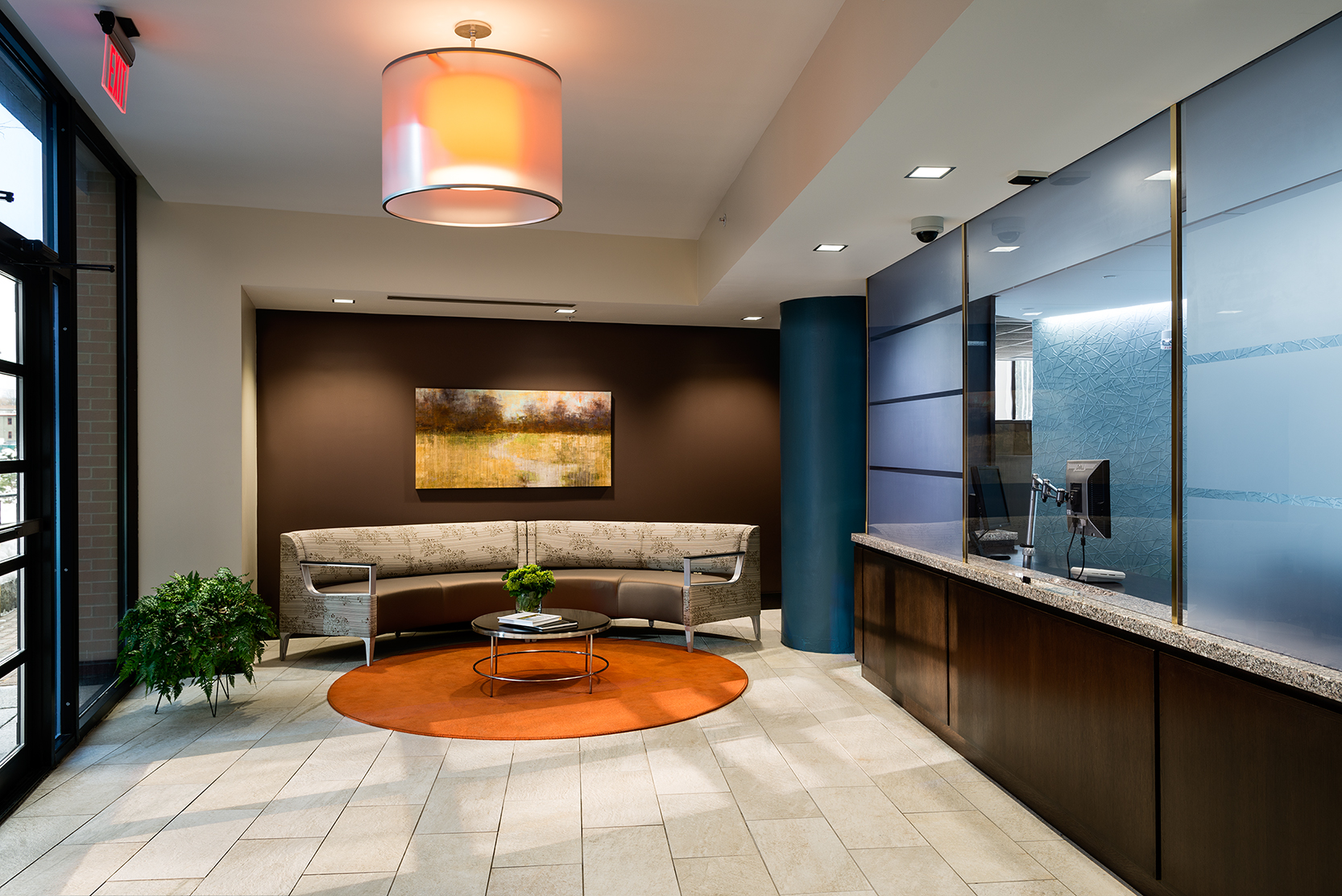 New, high-contrast finishes, lighting, and furnishings update this narrow lobby.