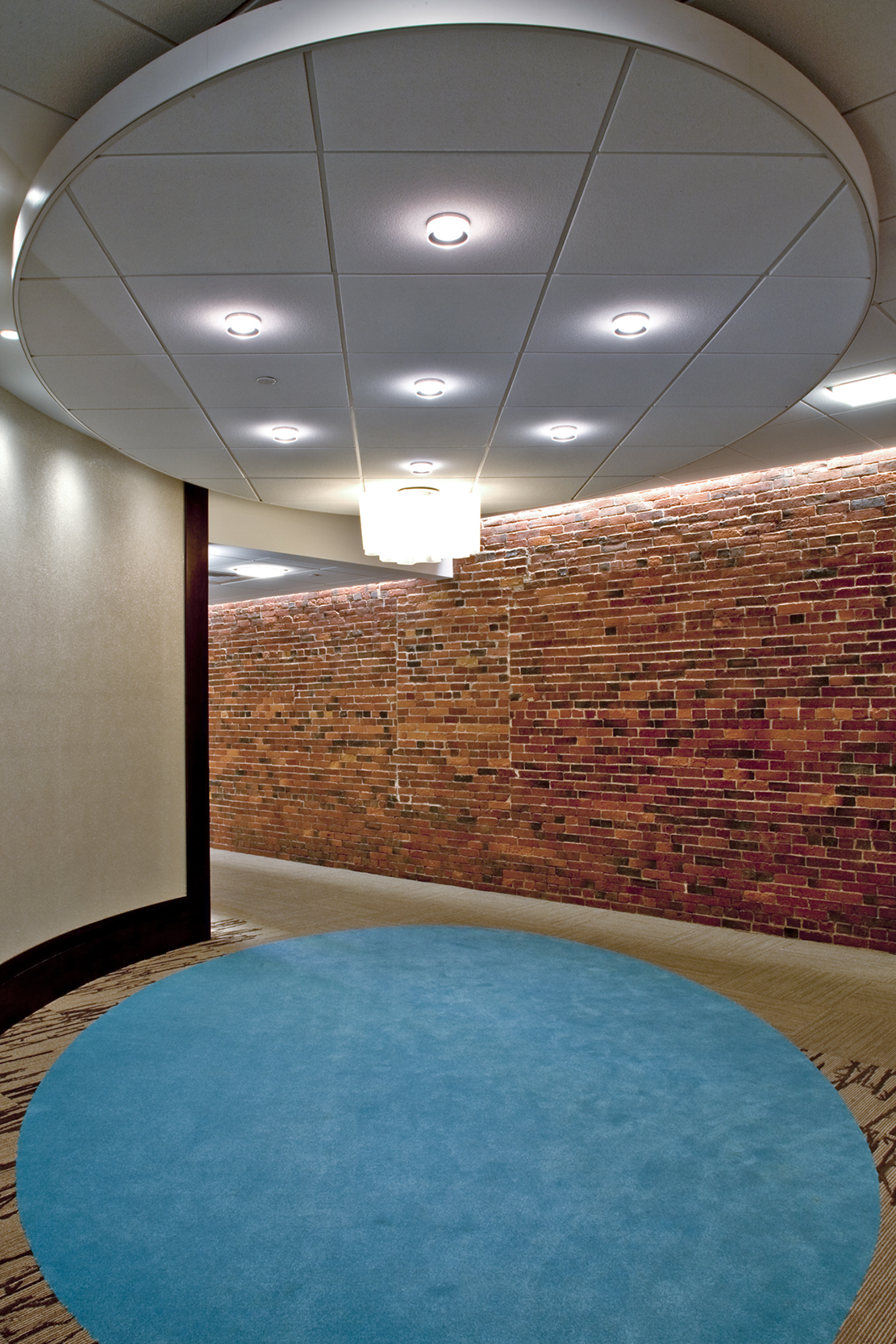 "A light ""cloud"" and corresponding carpet oval reassure visitors that they are in the right place."
