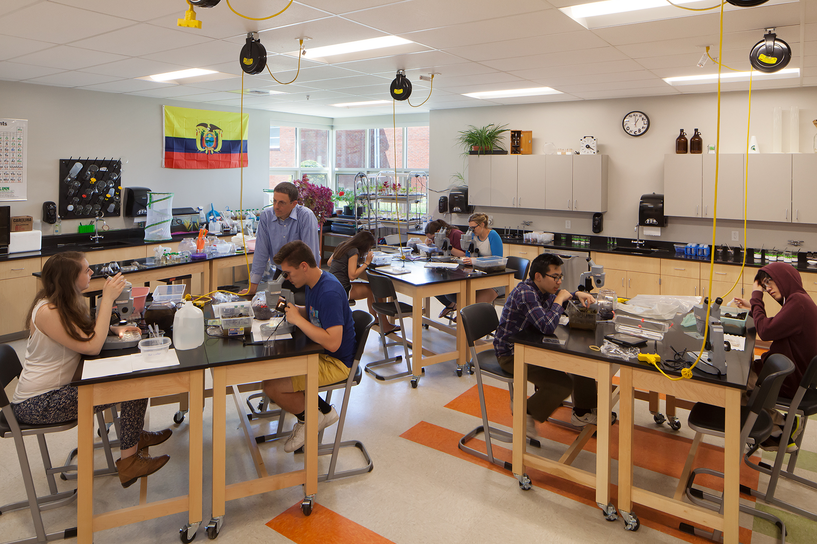 Students can easily rearrange the furniture in these science classrooms depending on the assignment. Power drops from the classroom ceiling enable students to plug in microscopes all over the room.