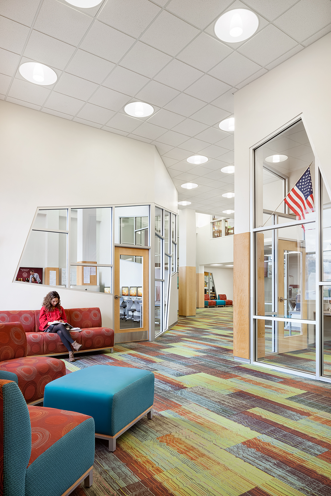 The former school library was renovated for the Arts + New Media Program, with transparent walls and a variety of seating.