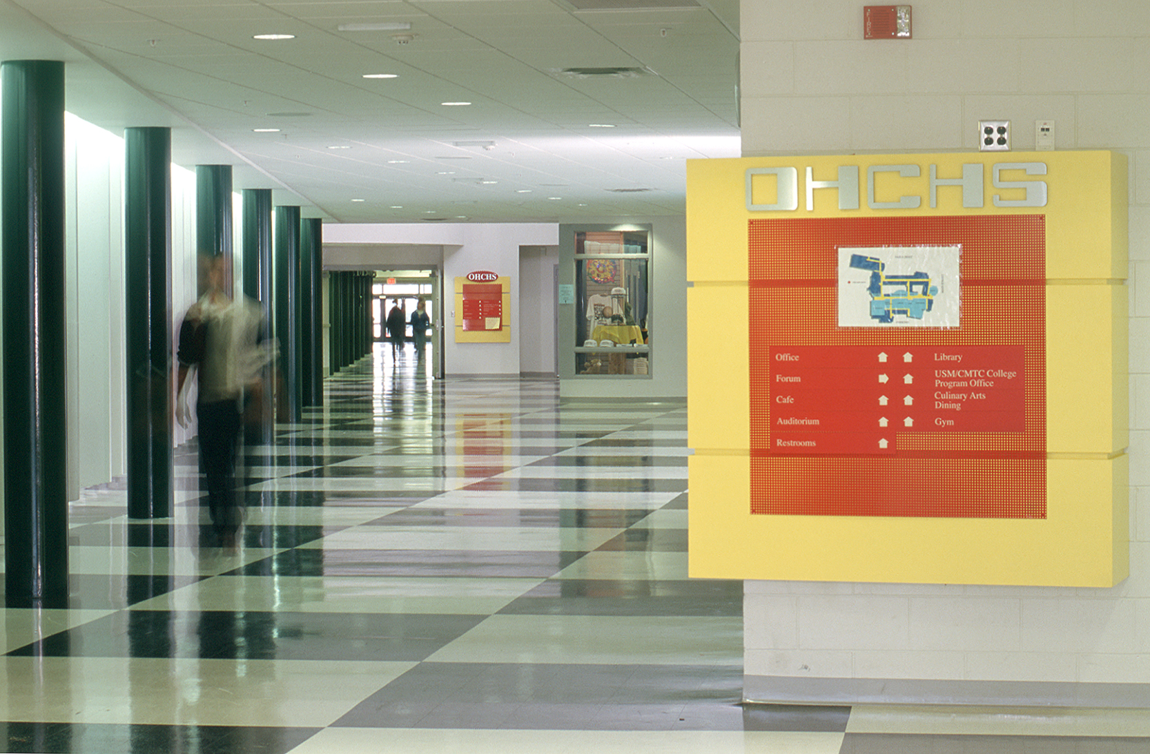 Integrated signage provides graphic wayfinding.