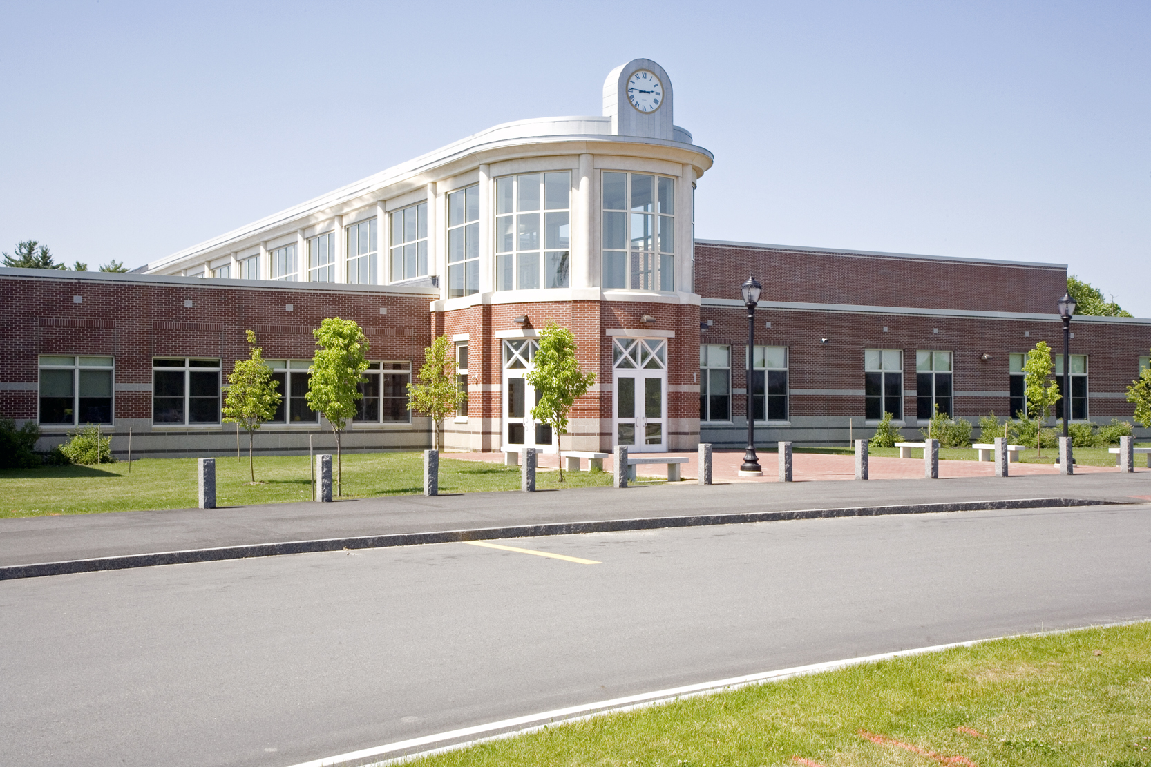 """The entry to the new Cony High School was designed to recall the original """"flatiron"""" Cony High School building, now converted to senior housing."""