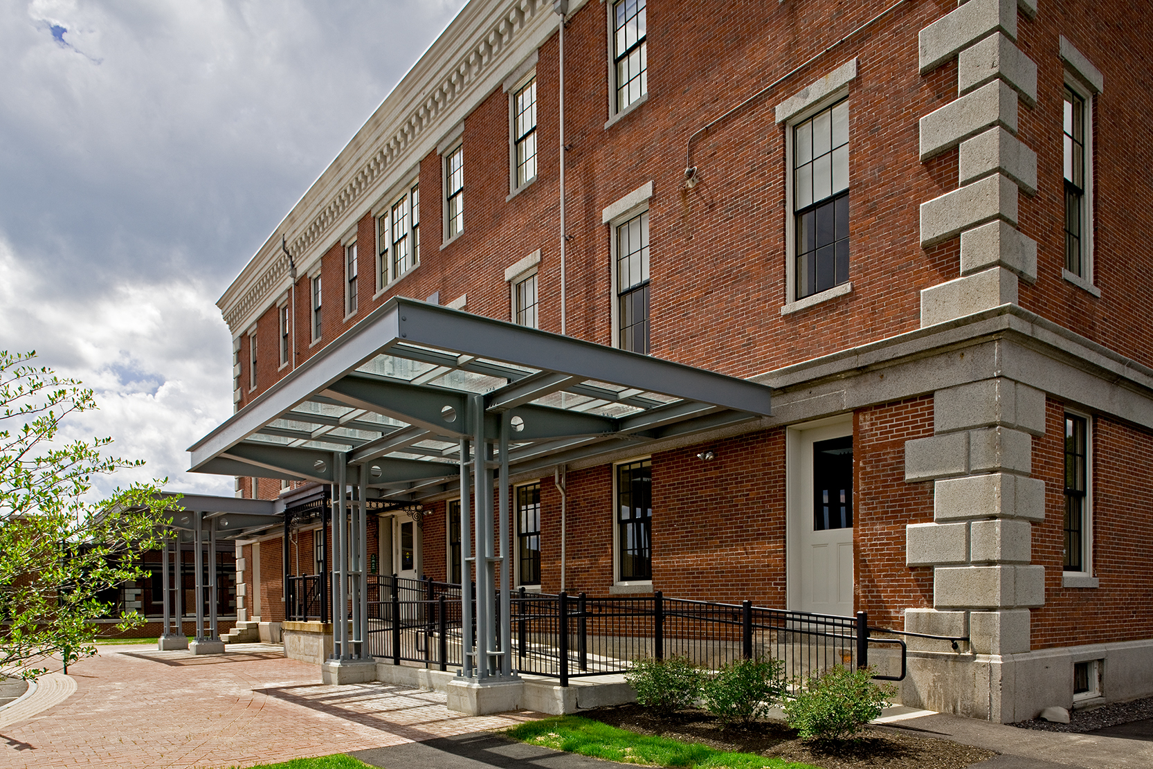 PDT added canopies to the back of the building to shelter the entry and wheelchair ramp.
