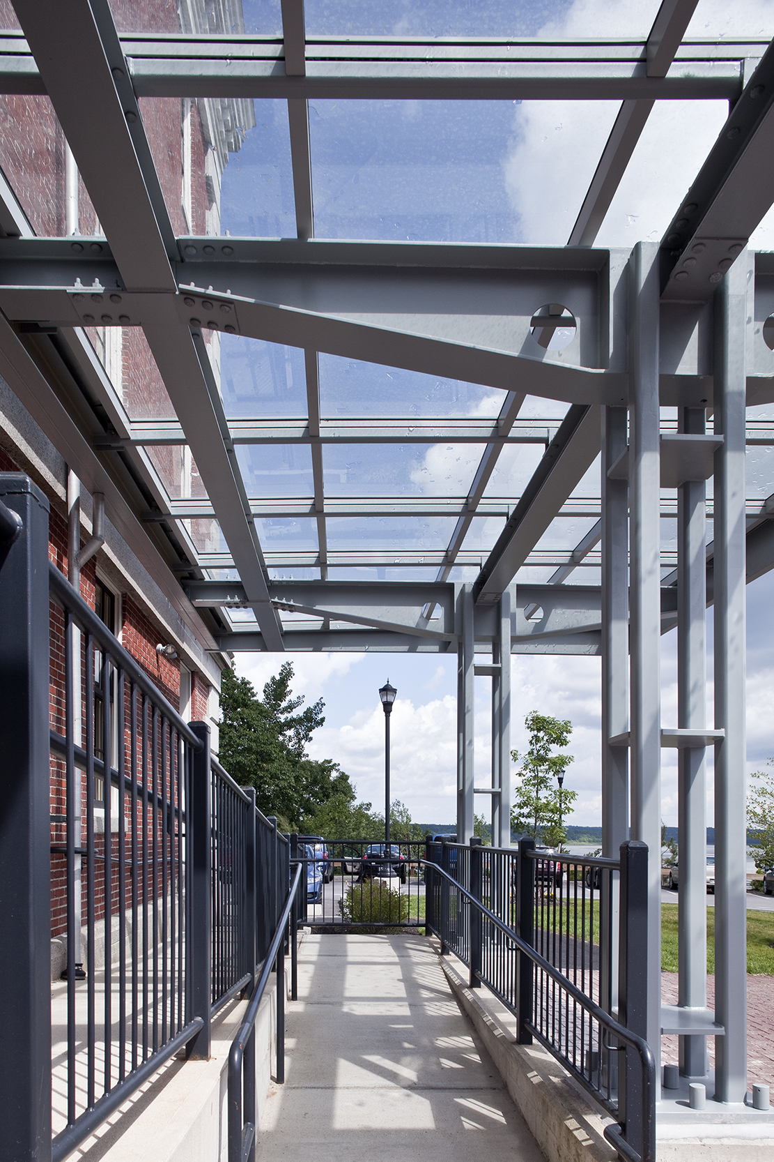 The steel-and-glass canopies provide a modern note against the traditional brick.