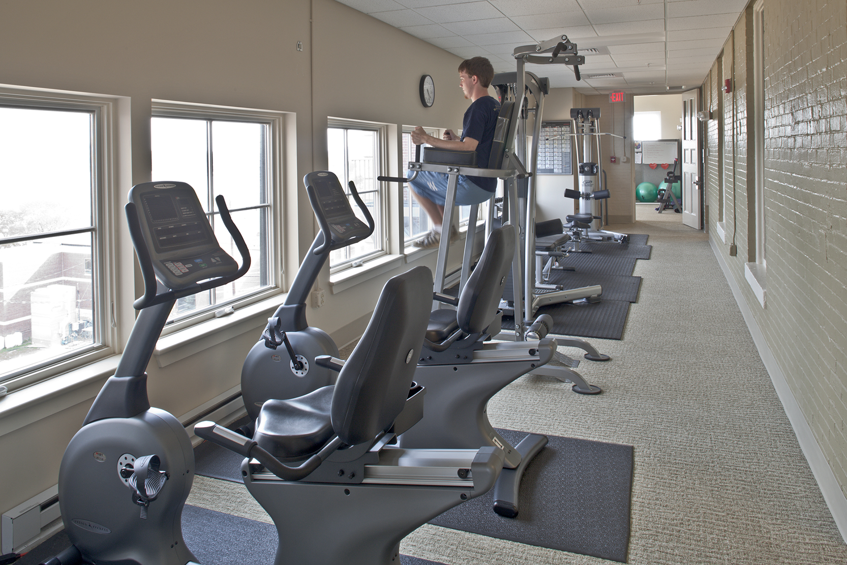 The second enclosed porch is part of the employee fitness center, which includes locker rooms, two exercise rooms, and commanding views of Casco Bay.