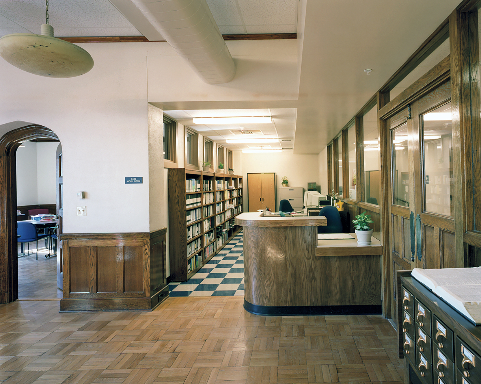 PDT was able to fit the MCJA media center into the school's old elegant library with new finishes. The antique light fixtures were reused.
