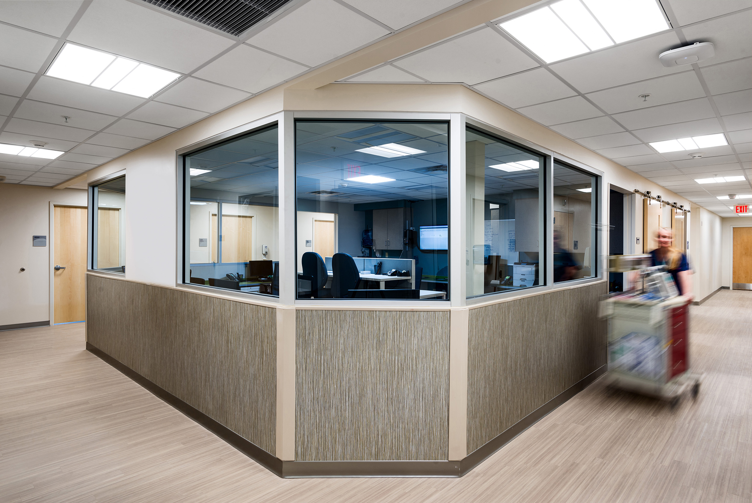 Provider bullpen centrally located with full visibility of exam rooms