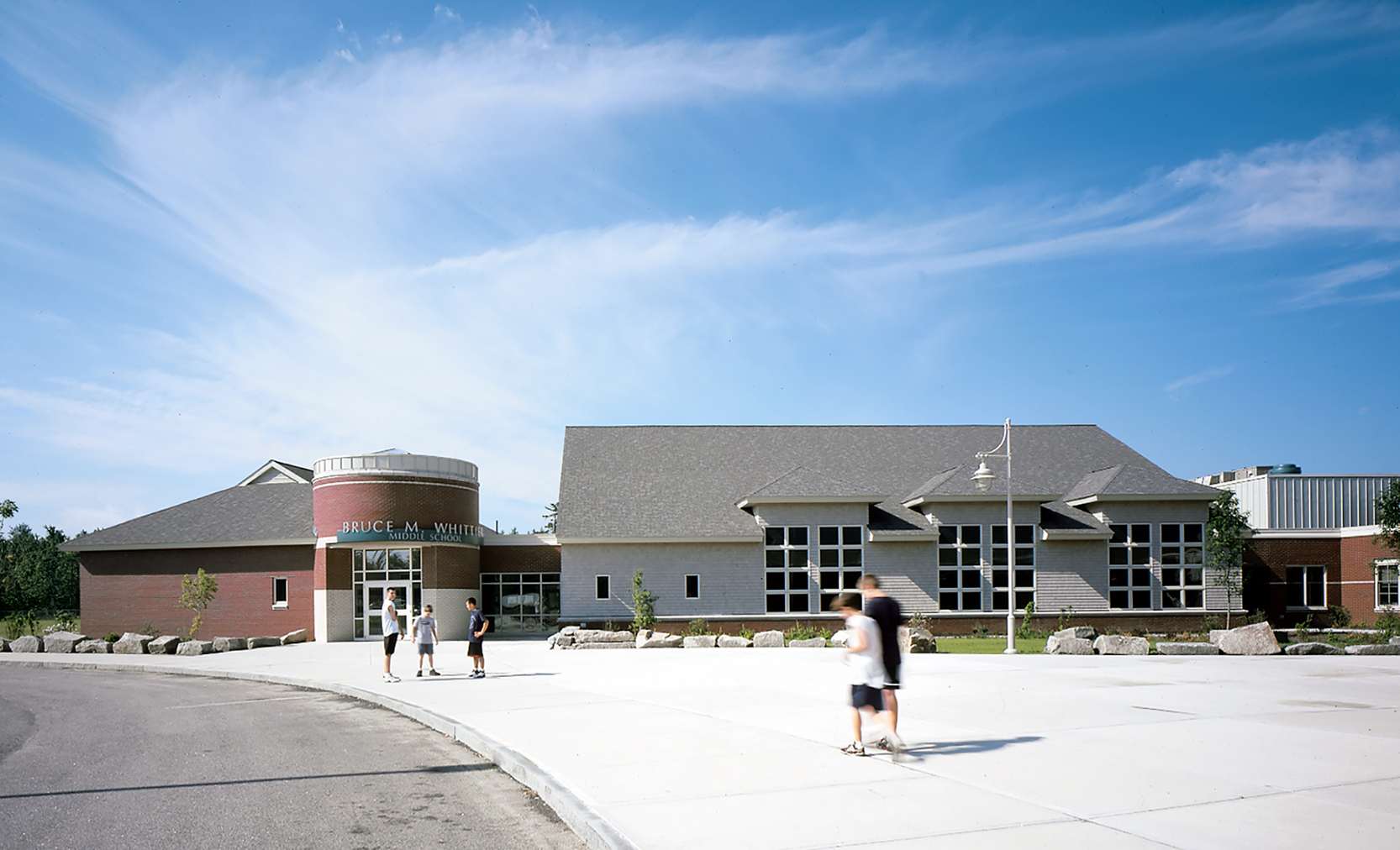 Whittier Middle School is a one-story wing attached to Poland Regional High School. The architecture of the two schools is quite distinct, though both have pitched roofs, a brick base, and high windows reminiscent of older buildings in the town.