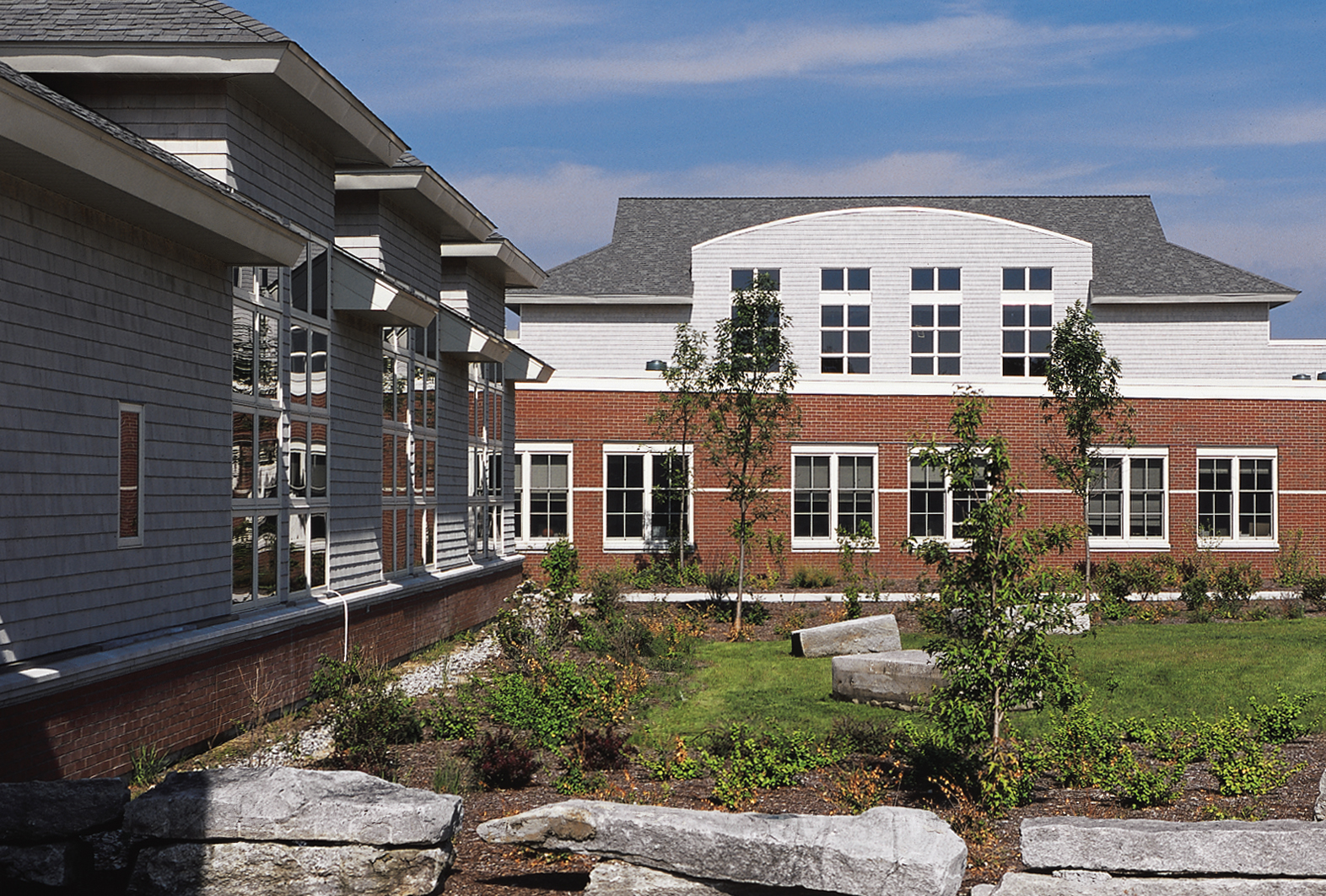 The stone courtyard with Whittier Middle School on the left and Poland Regional High School straight ahead.