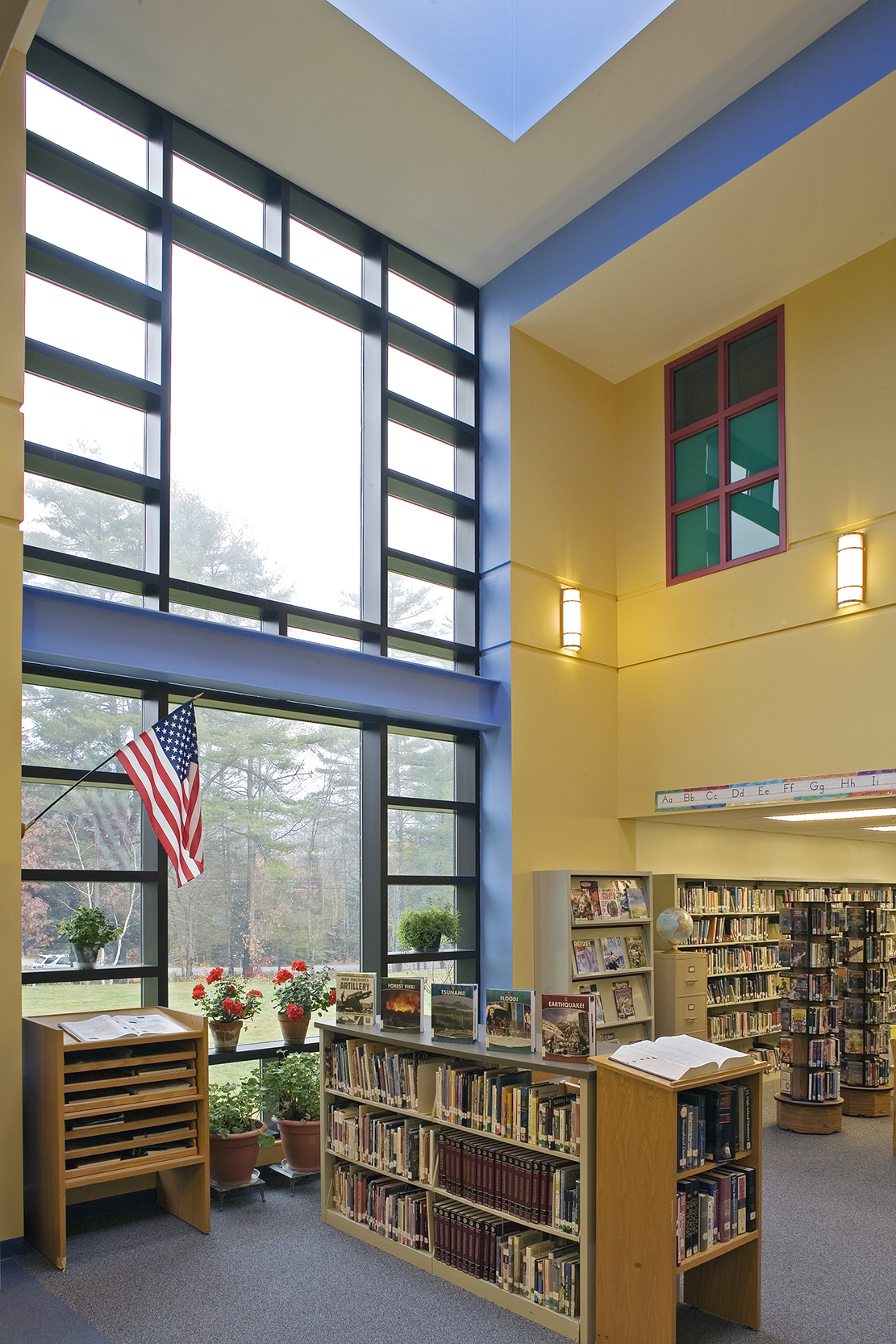 """Natural light floods the corner library and shares """"borrowed"""" light with adjacent spaces."""