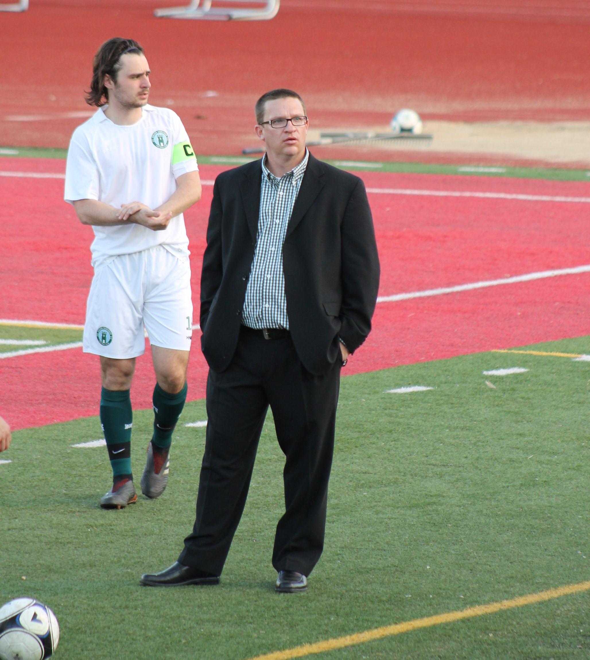 First-team manager Jon Denham and captain Ryan Pacholski