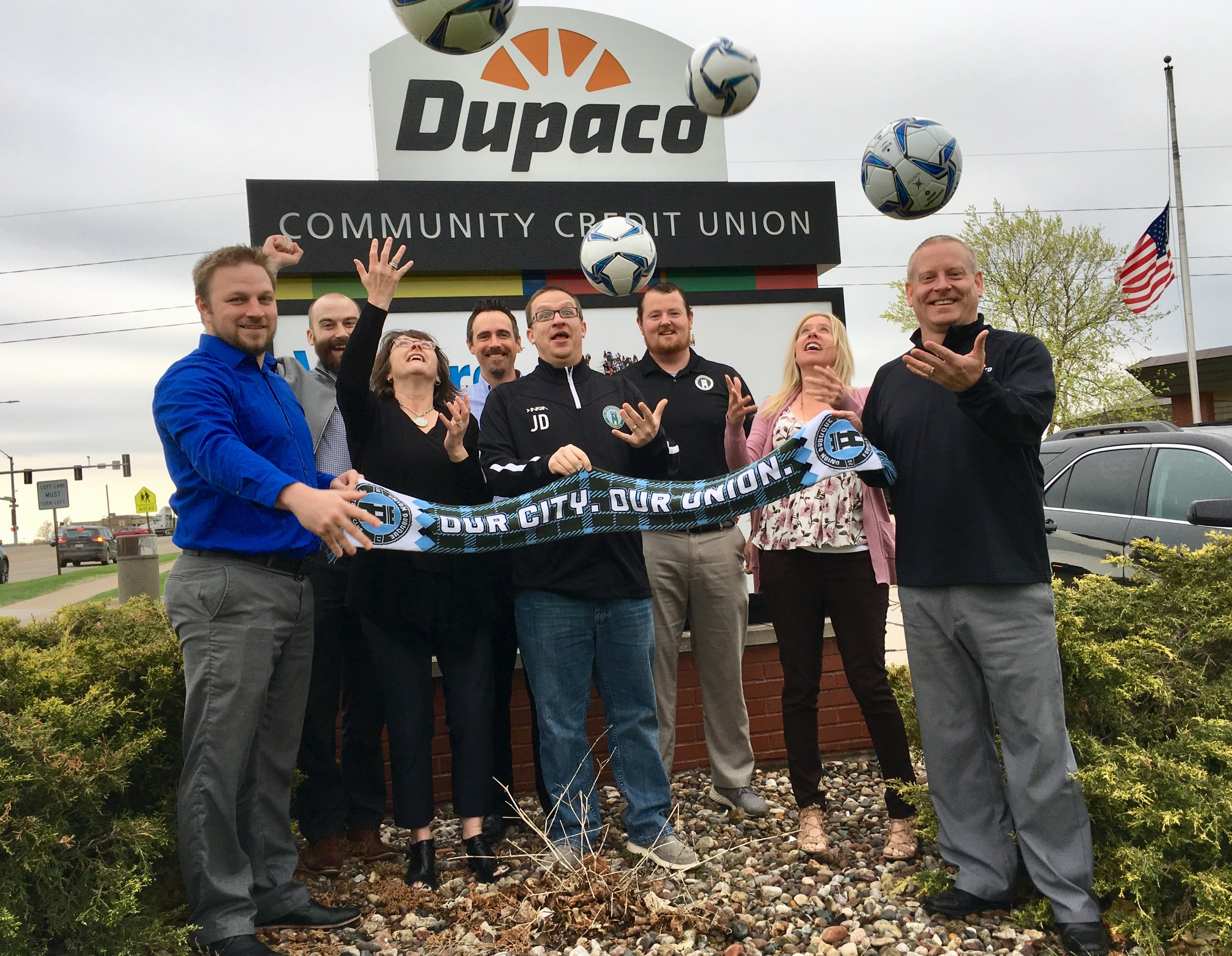A mixed contingent of Union Dubuque and Dupaco employees celebrate the partnership.