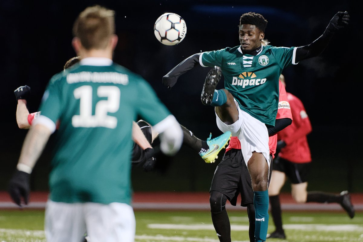 Union midfielder Patrick Asamoah battles for the ball in the air