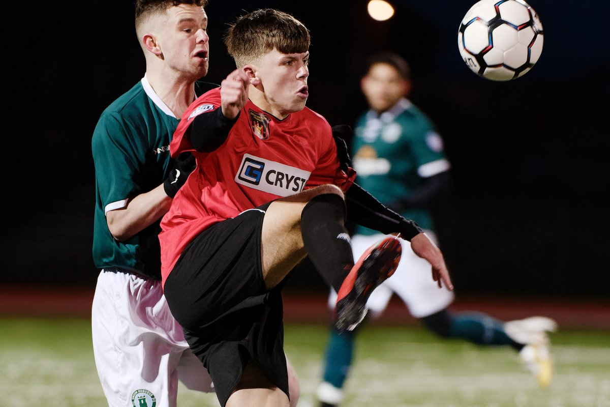 Union defender Josh Shelley challenges for the ball