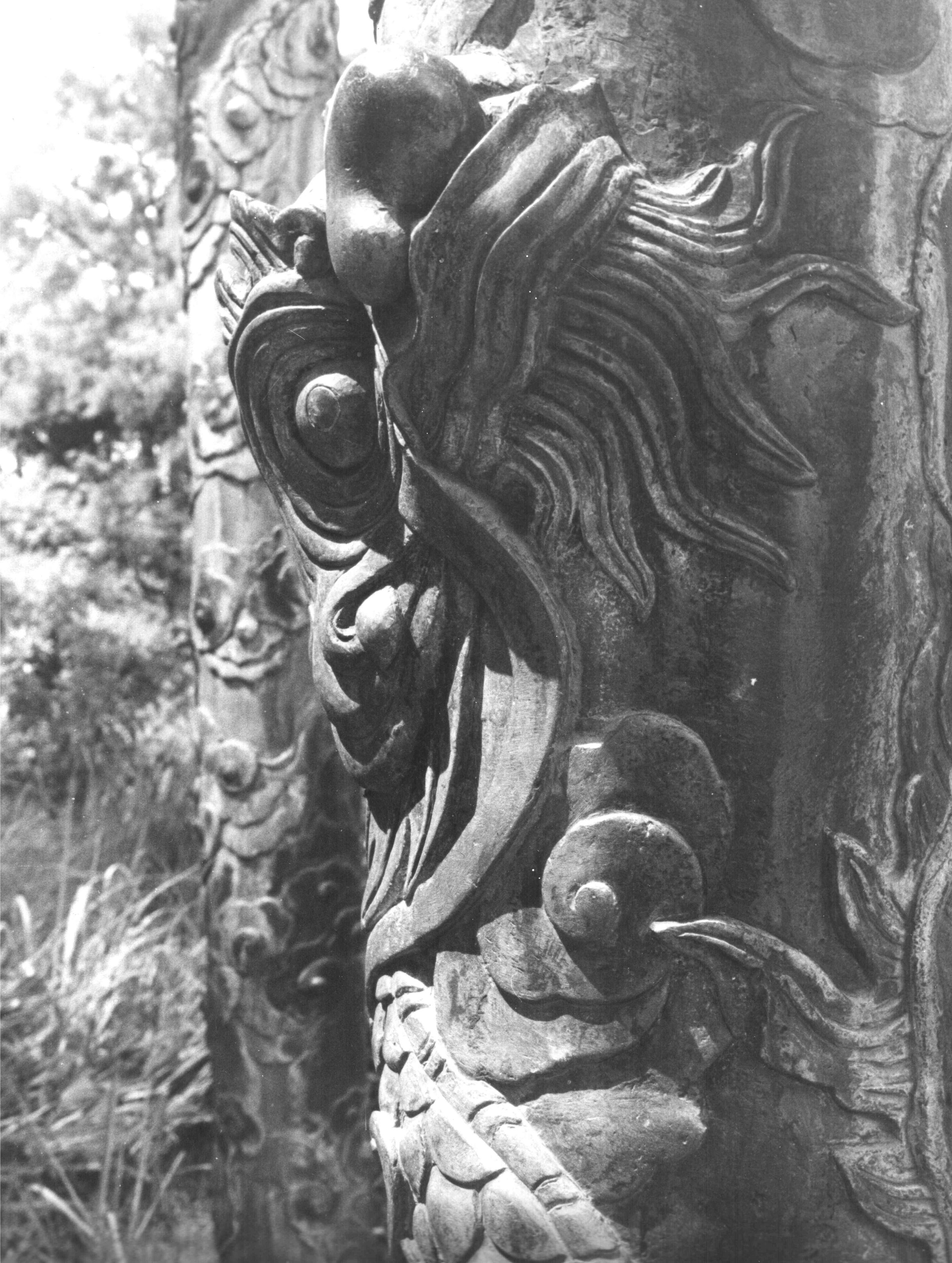 The Little Dragon: Detail carved into a column at the sepulcher of Emperor Minh Mang (1820-1841). Photo by the author.