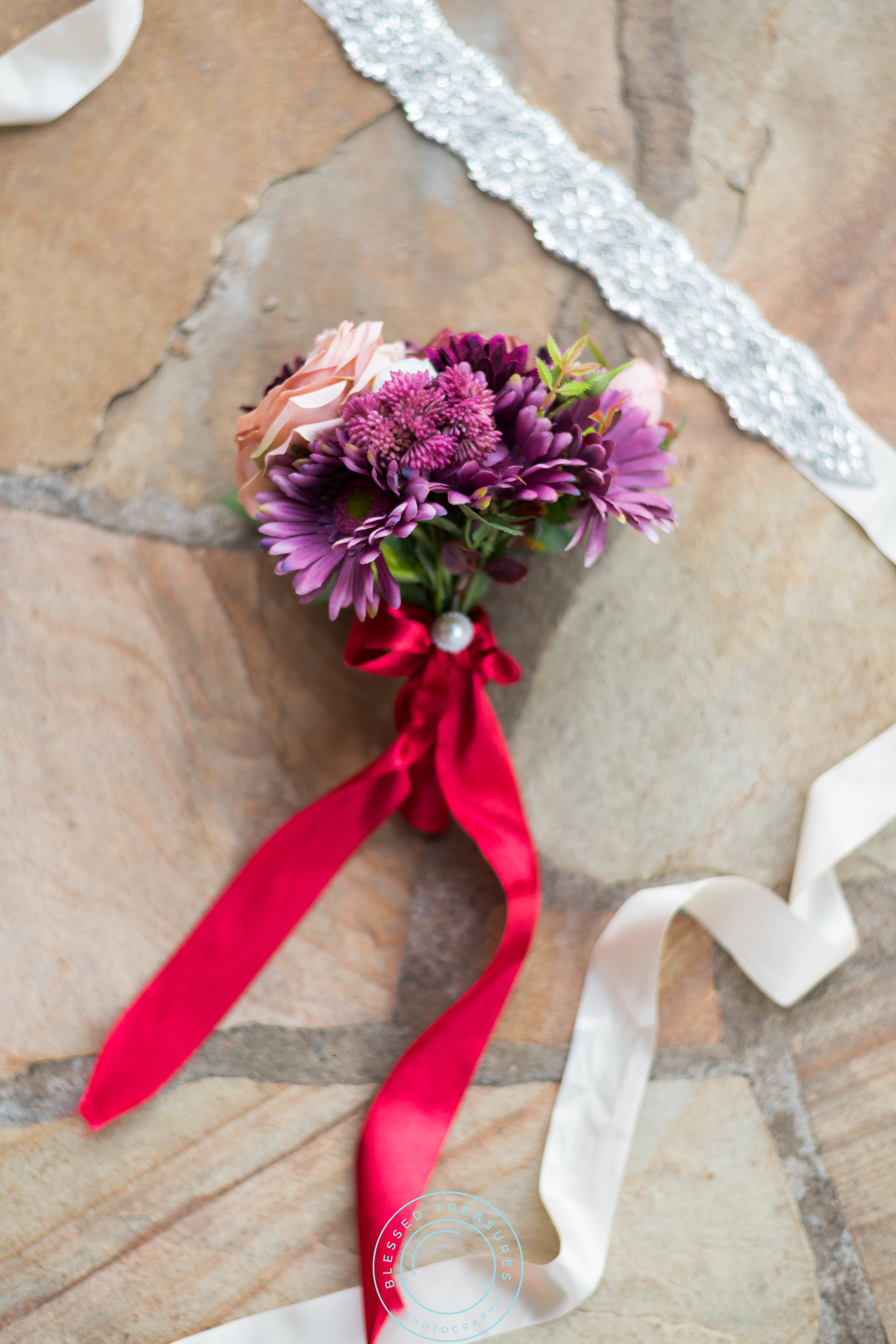 wedding flower bouquet pink roses purple daisies greenery red ribbon tie pearl