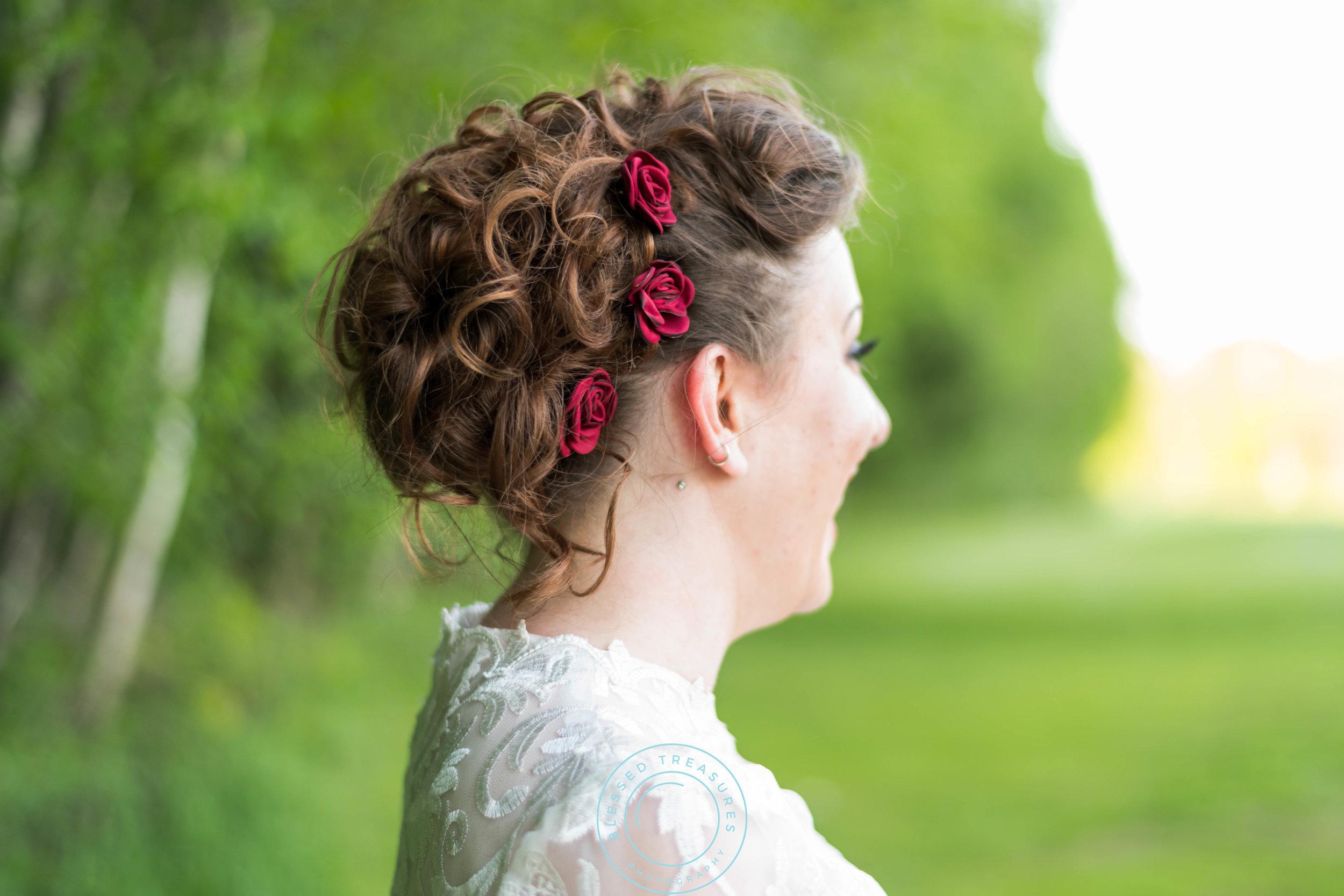 curly brunette wedding updo red roses