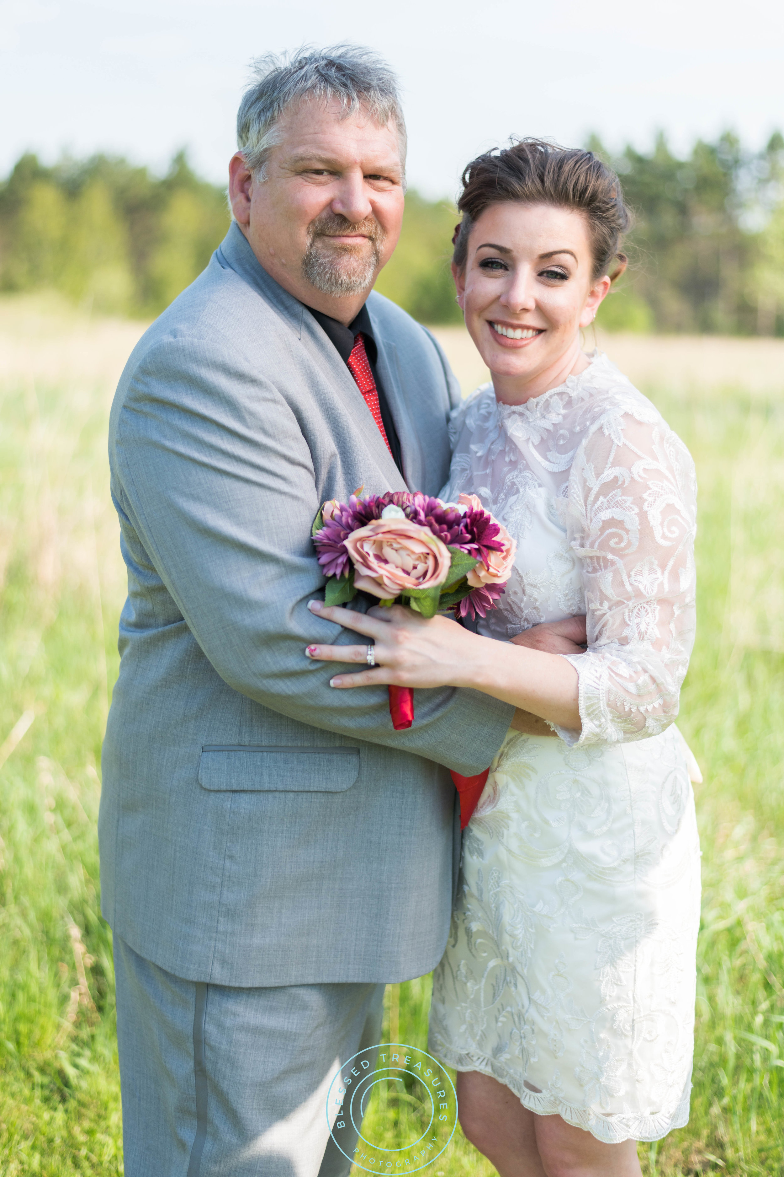 Mansfield township pioneer church crystal falls michigan wedding bride and groom portraits romantic fun happy lace dress red pumps grey suit curly brunette wedding updo