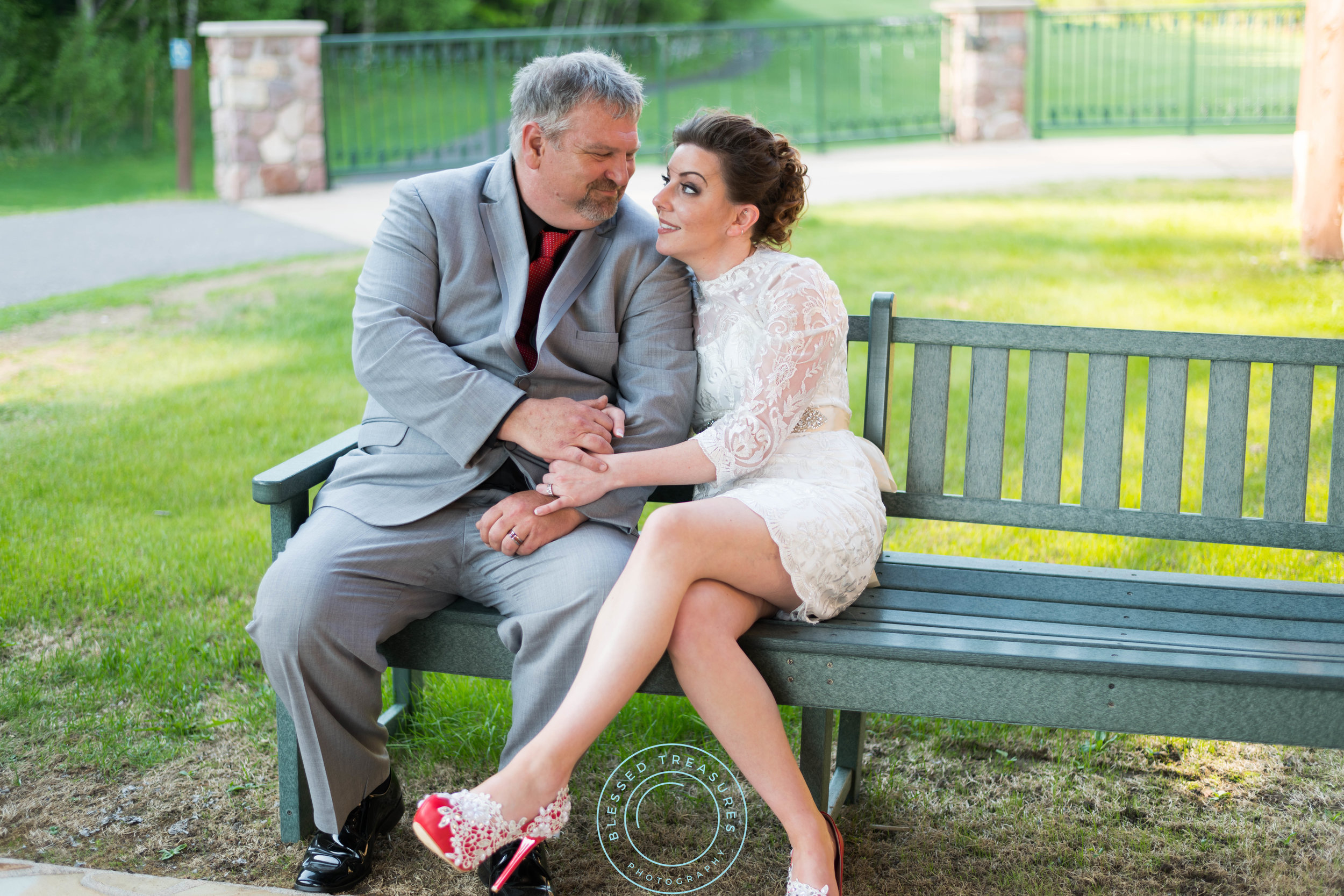 George Young complex banquet hall golf course michigan wedding bride and groom portraits romantic fun happy lace dress red pumps grey suit curly brunette wedding updo
