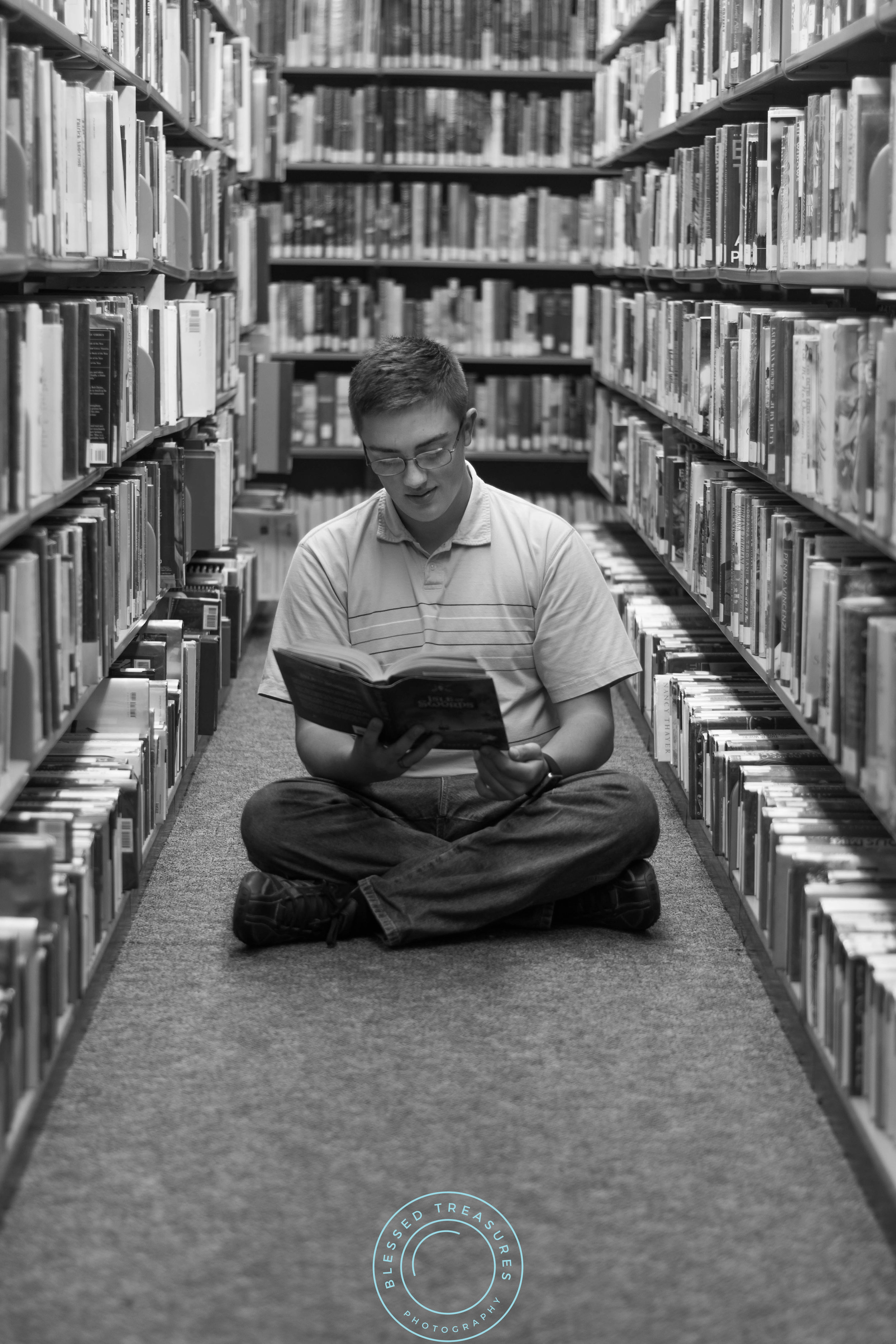 Andrew Navis senior session Iron Mountain Millie Hill bat lookout dickinson county library book reading on floor book shelves bookworm