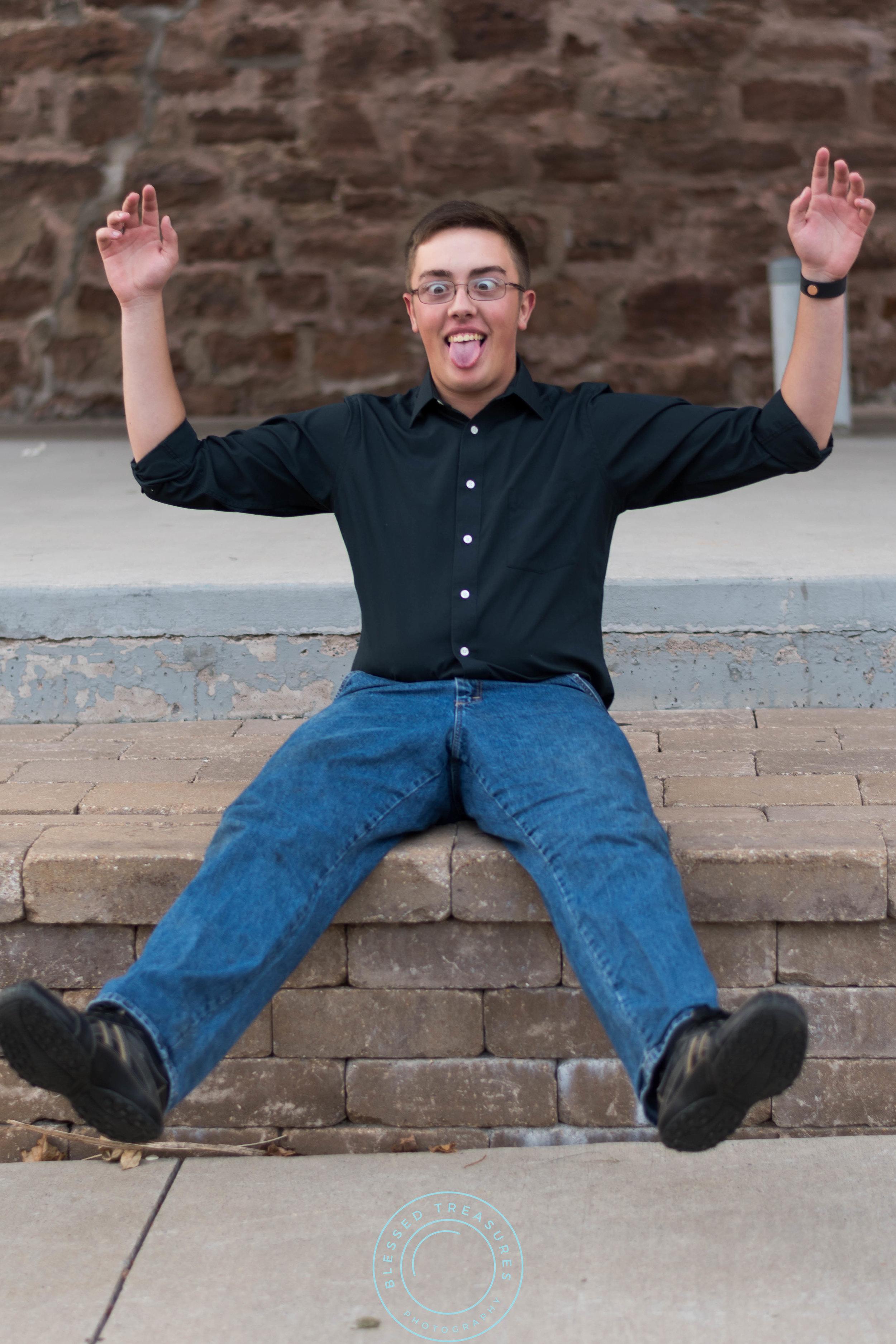 Andrew Navis senior session Iron Mountain downtown funny rustic edgy brick vintage