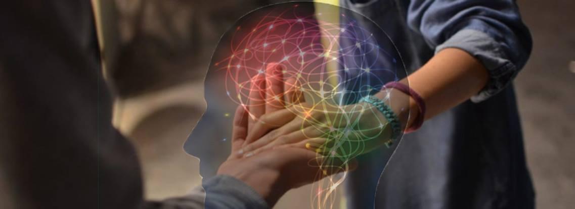 brain illustration over touching hands.jpg