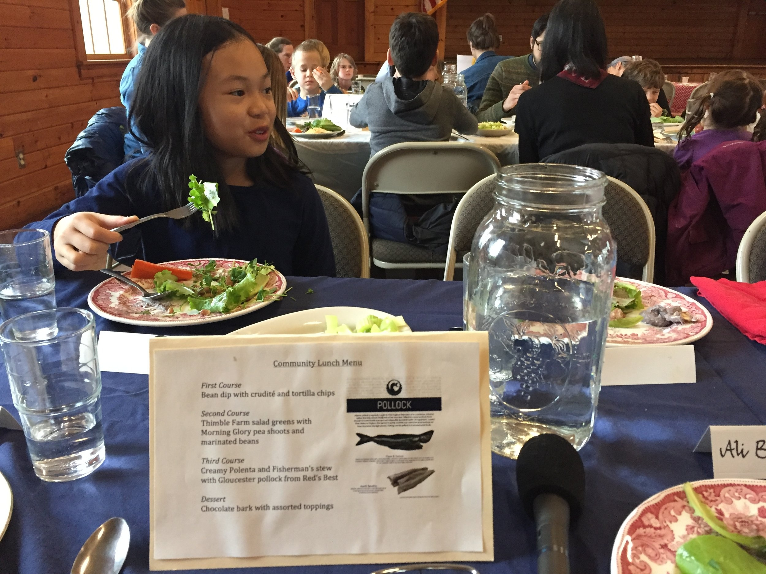 5th grader Laina with salad and the day's menu.  Photo: Ali Berlow