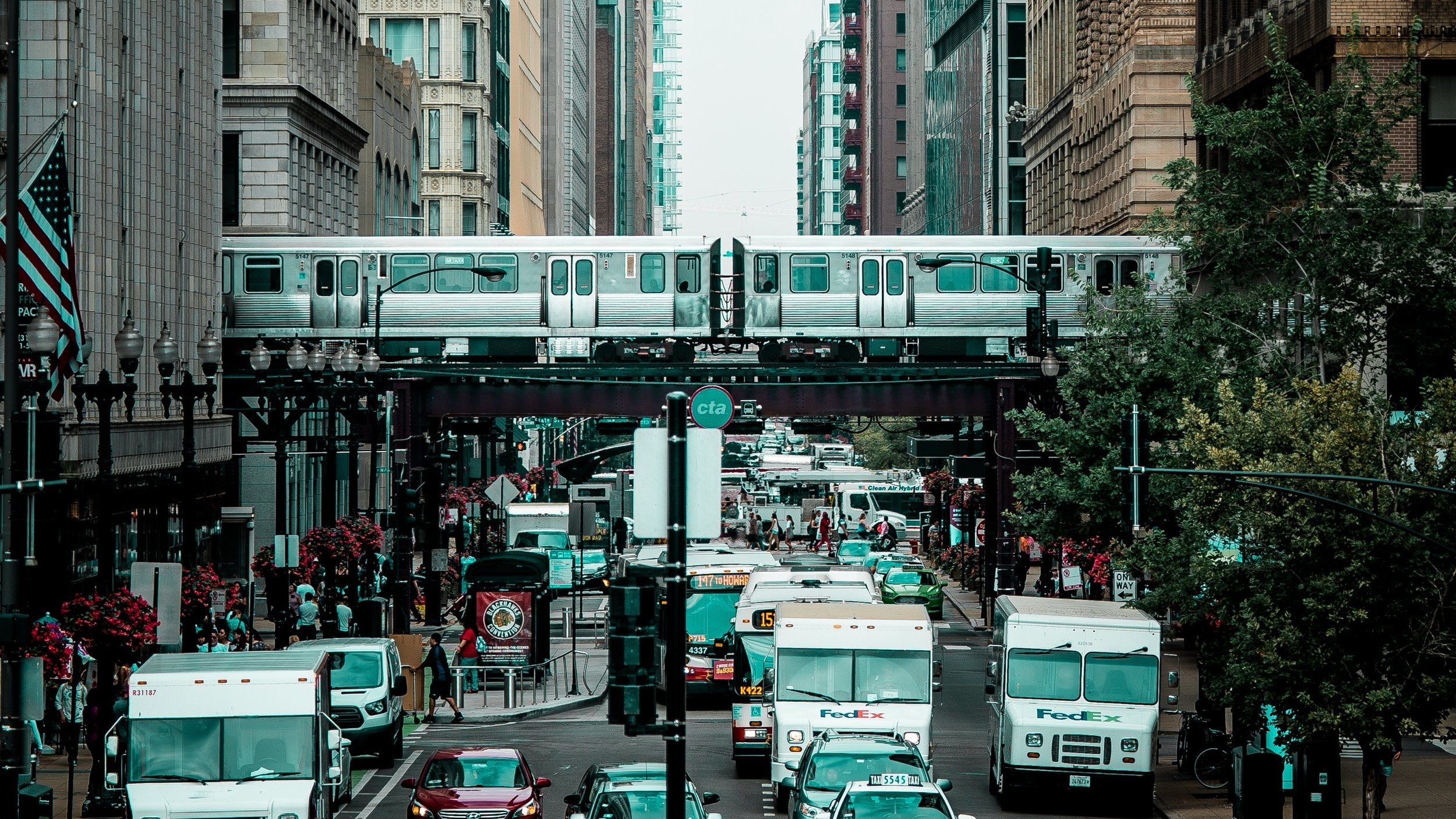 The L runs above city streets in downtown Chicago.