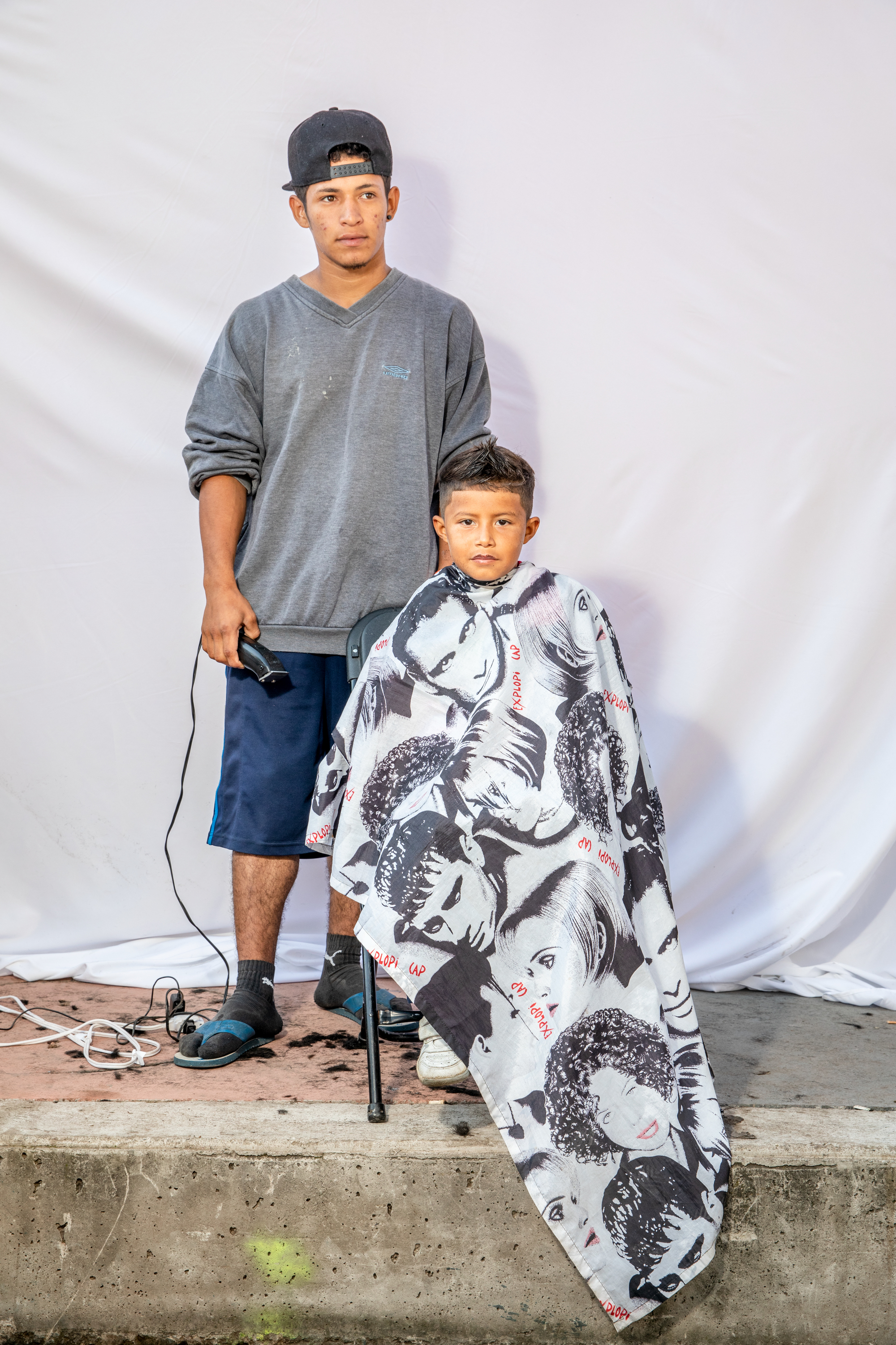 """I want to get to the States, to learn English. I do not want to return to my country,"" - said Elder Claros Martínez, 7 years old, from Ocotepeque, Comayagua, Honduras, while he was getting his hair cut at the caravan camp in Mexico City.""They charge you just for living, the tax of war as they say,"" said Herson Manuel, 19 years old, from San Pedro Sula, Honduras. The day he left, he had to pay his monthly bills for his barbershop, but that did not leave Manuel with enough to pay the gangs their fee, ""I better go, I said.""""I'm afraid of the gangsters. They say that if you leave the neighborhood and then later return, they will kill you. It's like me, if I go back, they will kill me. None of us (in the caravan) can go back for the same reason."""
