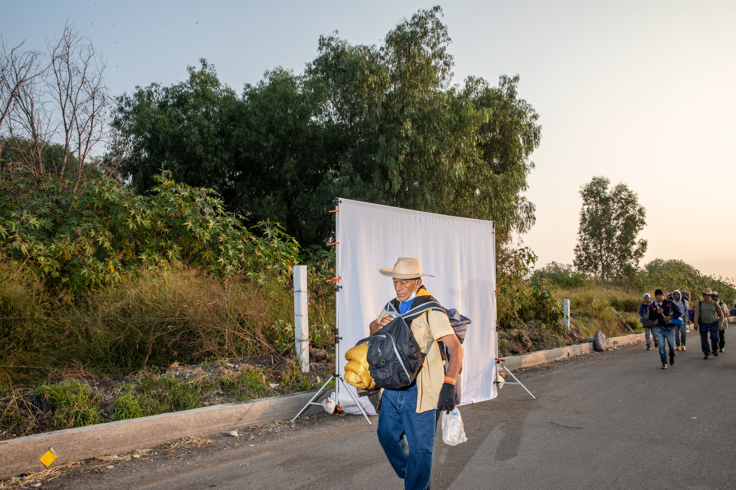 People making up the migrant caravan, traveling from Central America, walk on the highway out of Queretaro, Mexico, November 11, 2018.