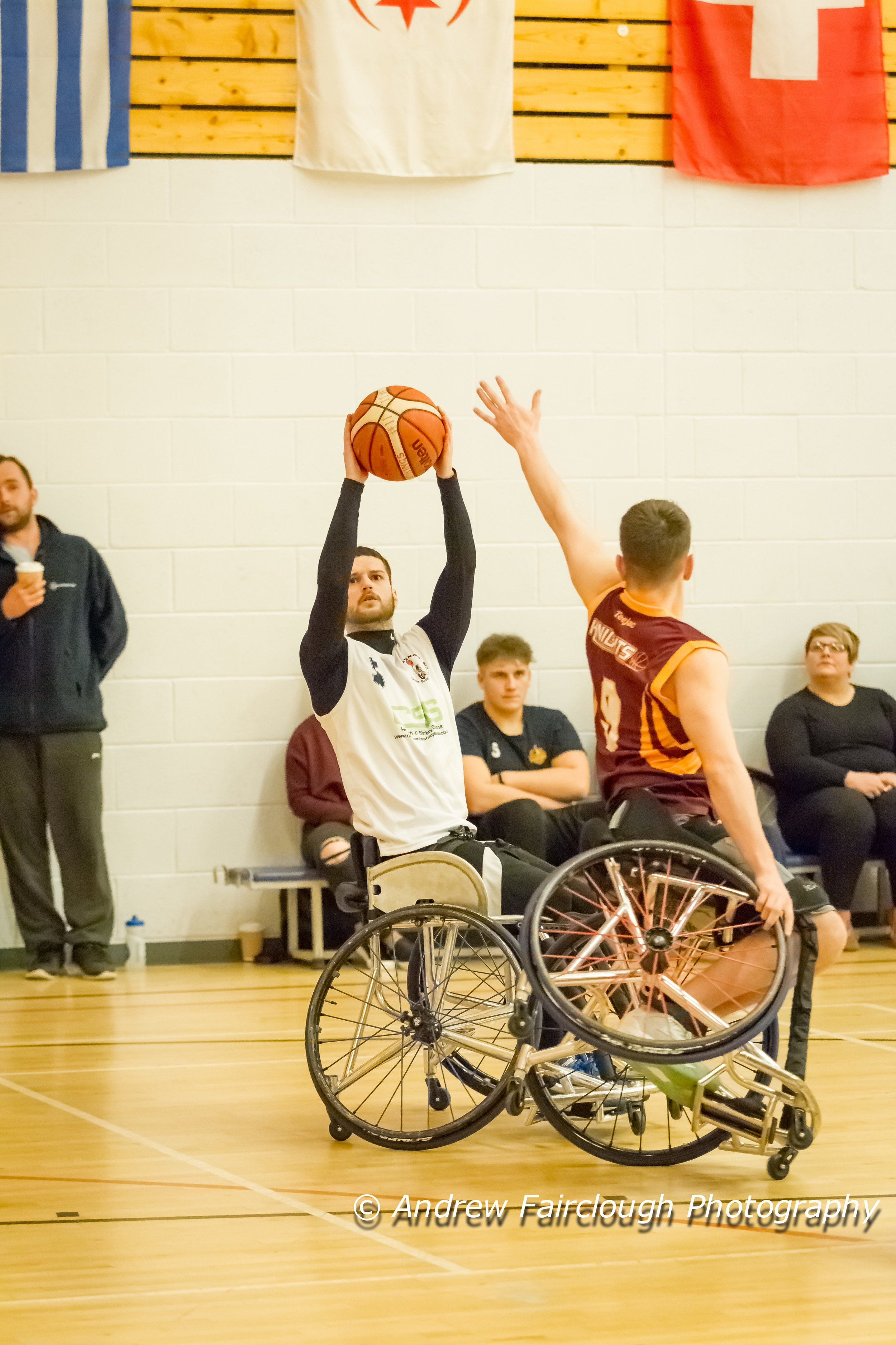 classic wheelchair basketball action , block attempt on one wheel ( Vikings v's Knights March 2017)