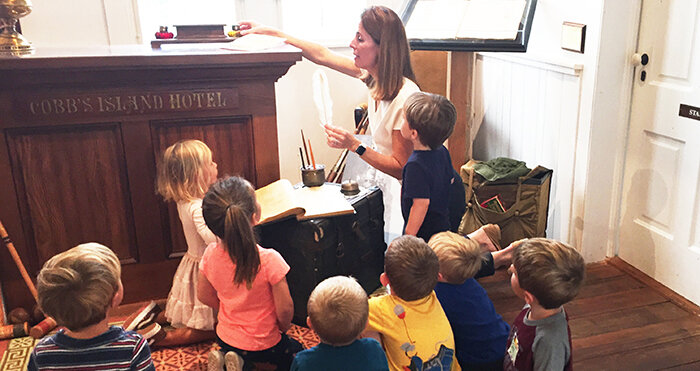 Pre-Kindergarten students learn about the Cobb Island Hotel from Sally Dickinson of The Barrier Islands Center.