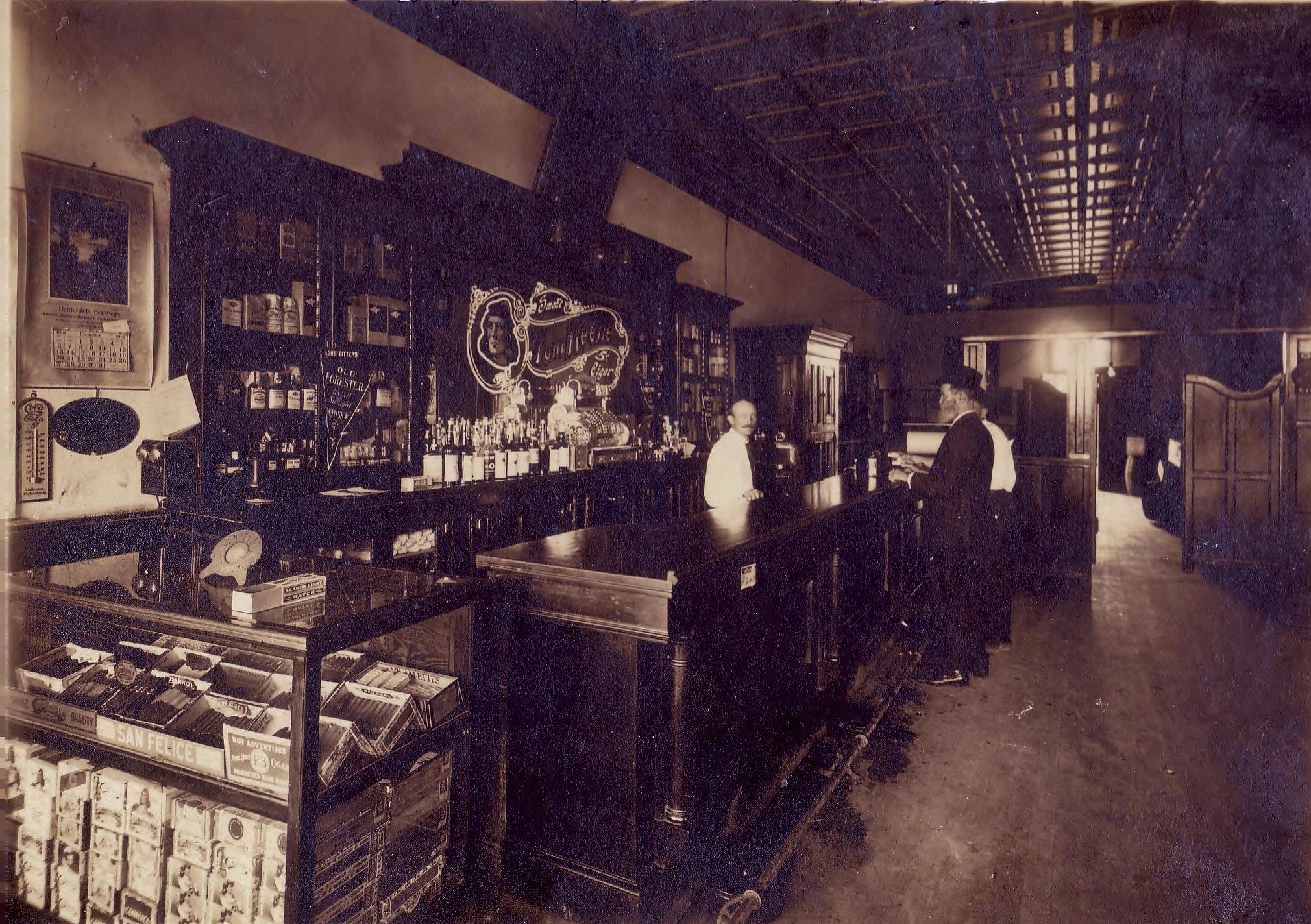 1912, Oct - Paul Schilo in brothers saloon.jpg