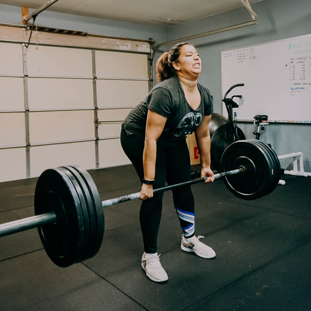 Divya setting a Personal Record on her deadlift at 185# a year after we began training.