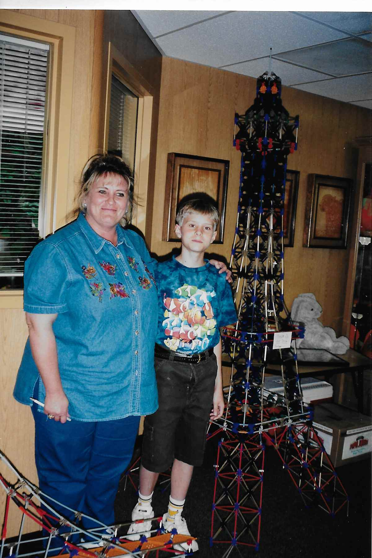 Nicholas and his 4th-grade teacher, Rocky Wilson, and his K'NEX Eiffel Tower.
