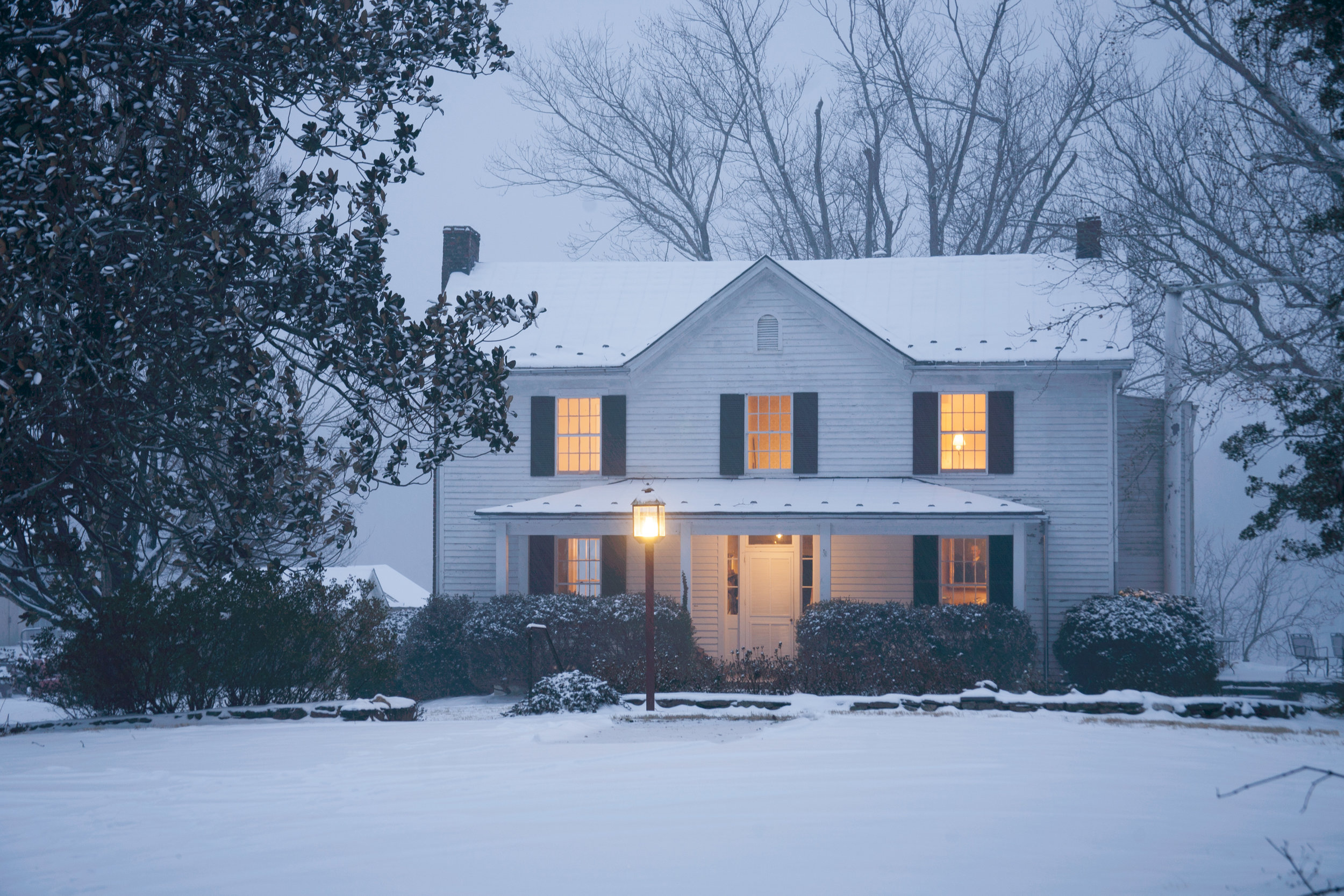 The snow-covered farmhouse