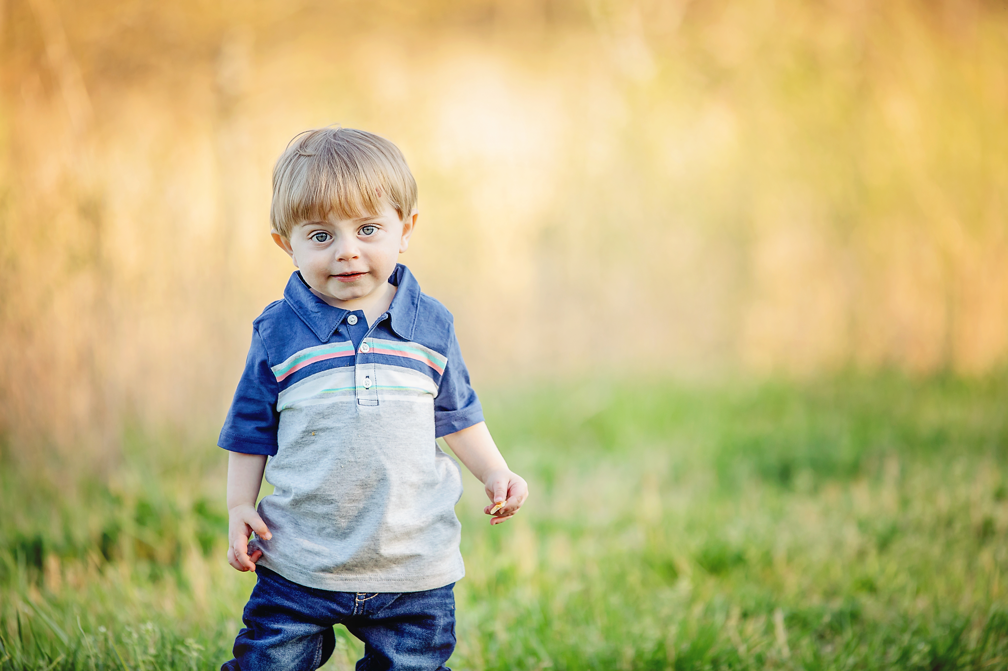 How adorable is this little guy?  I really love how the setting sun was hitting the tall grass behind him.