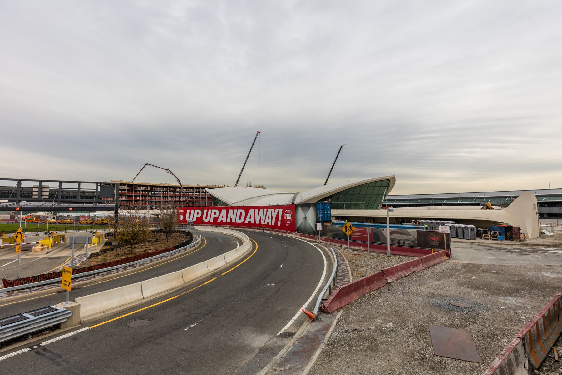 The Vintage Themed TWA Hotel Tops Out Next To The Eero Saarinen-Designed TWA Flight Center At JFK International Airport
