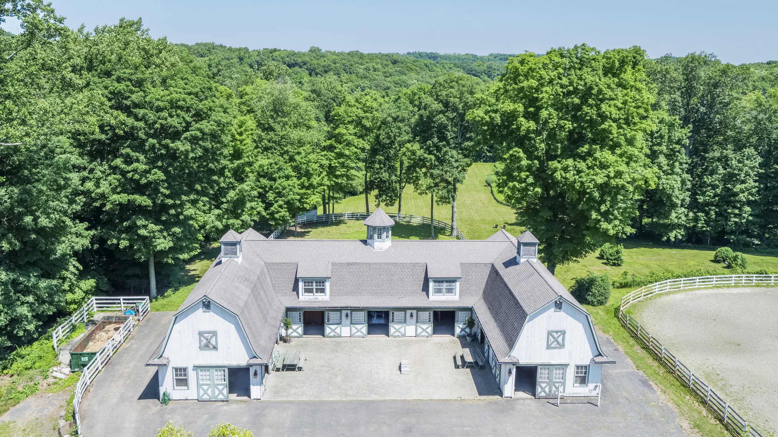 Tour The Sprawling Grounds of This 30+ Acre Equestrian Estate On Greenwich, CT's Prestigious Round Hill Road