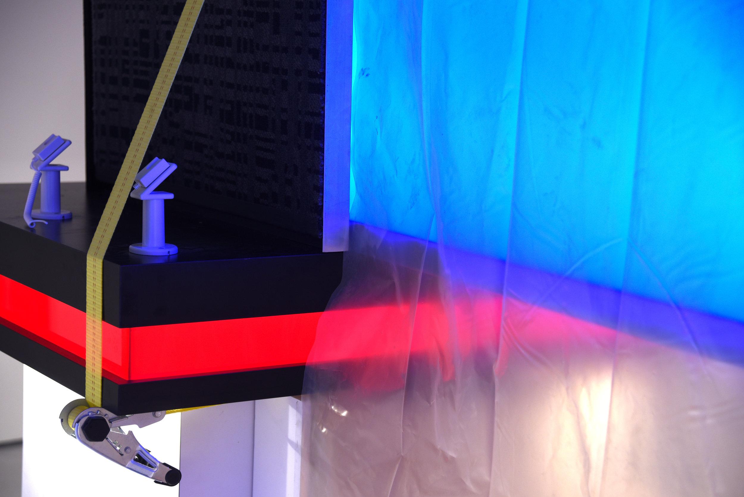 Jonathan Mildenberg  I.N.C.H. ,2018 (detail) wood, Formica, plexiglass, LED lights, ratchet straps, prefabricated cellphone security displays, carpet, foam, plastic tarp, rubber,tile, cardboard, steel, prefabricated light box, subwoofer, aluminum, self-adhesive vinyl, drywall, bed sheet, yoga mat, fabricated,neon light, mirror, porcelain tile, epoxy dimensions variable (JM6)