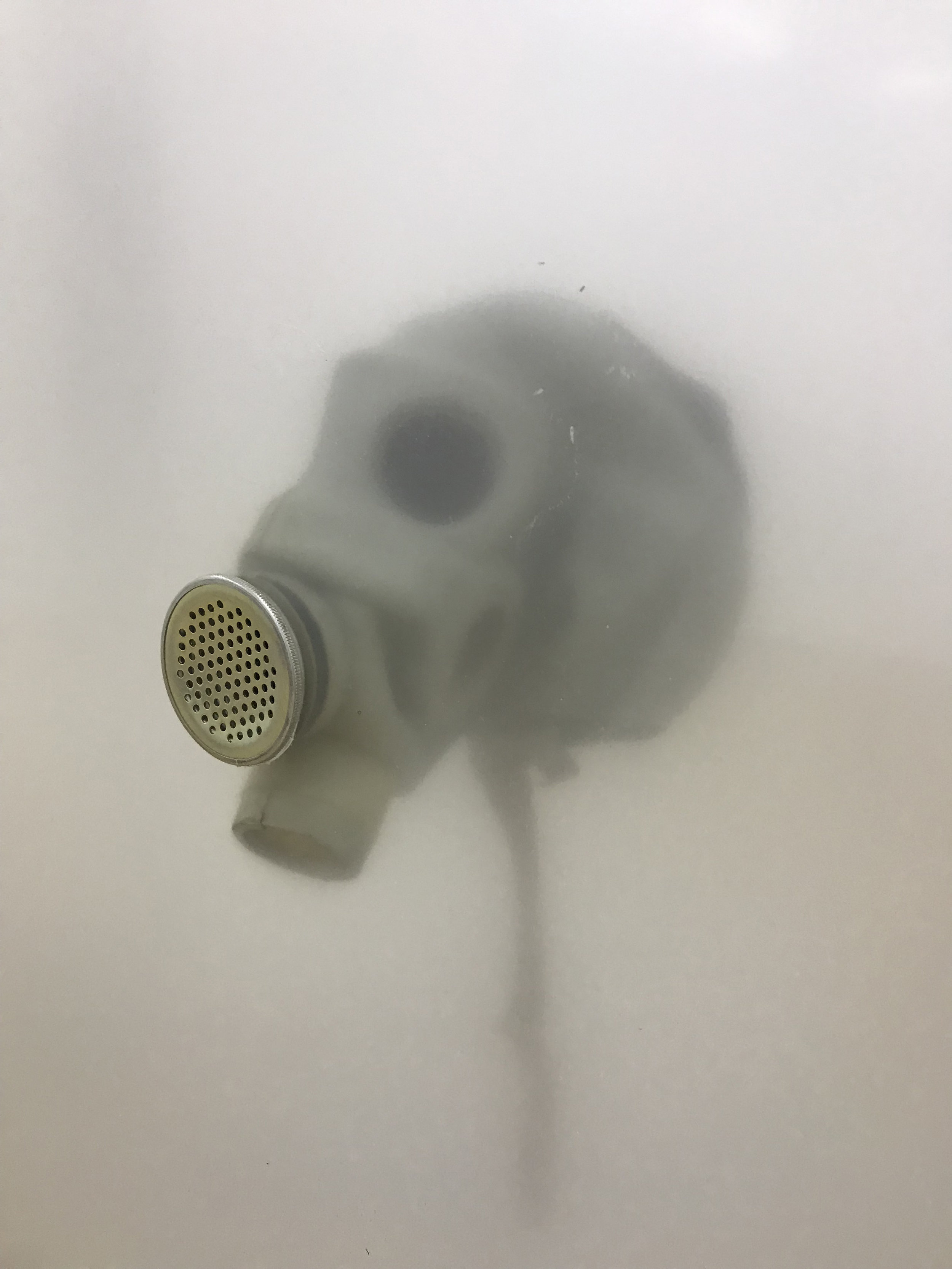 Vladislav Markov  Untitled , 2018 (detail) library shelves, Plexiglas, polyurethane engine cast, gas mask, fog machine,  plastic hose, self-adhesive carpet protector film 84 x 84 x 24 inches (213 x 213 x 61 cm) (VM3)
