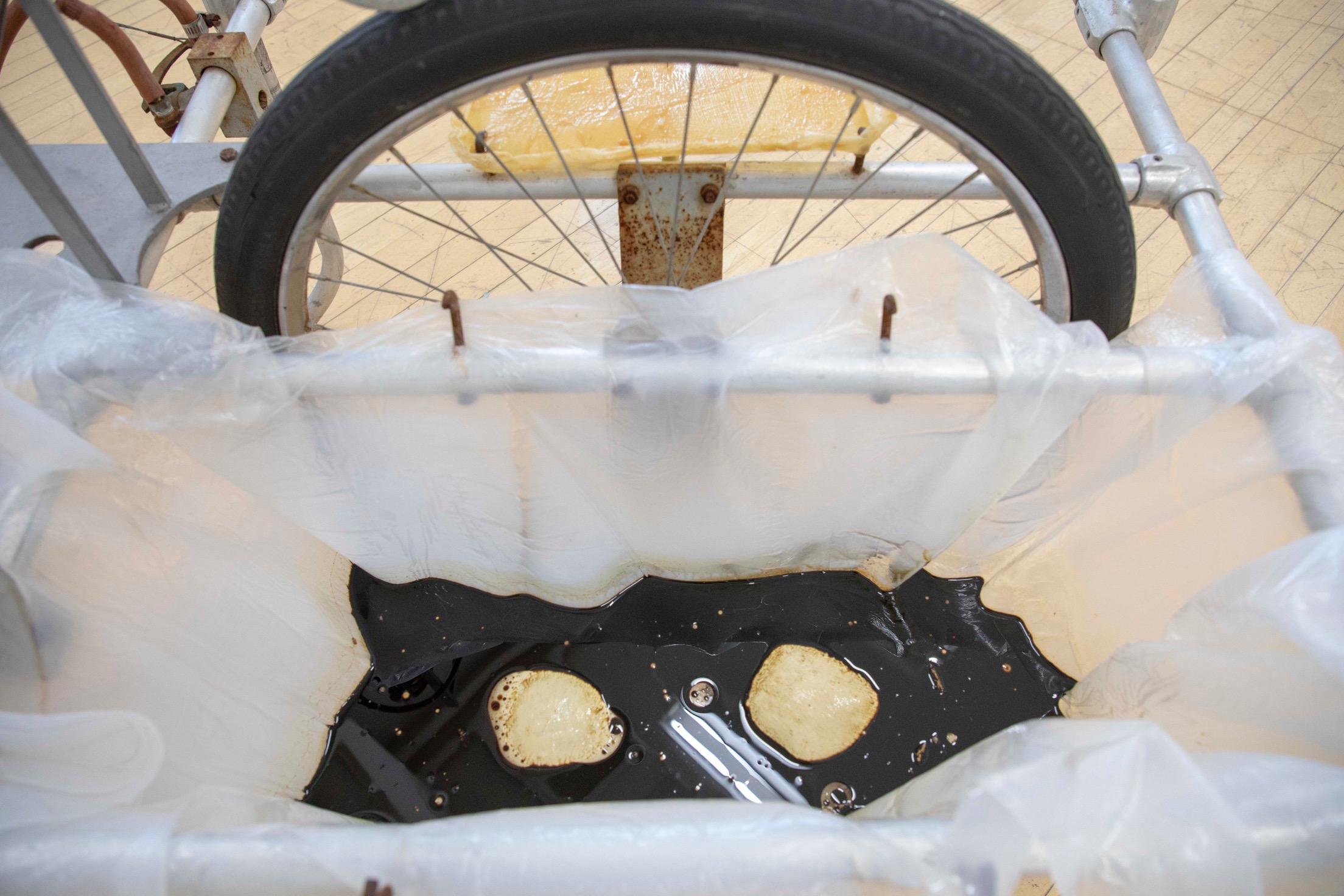 Vladislav Markov  kR , 2018 (detail) silicone bag, water, used motor oil, latex knees casts, aluminum spring, fishing hooks (VM2)