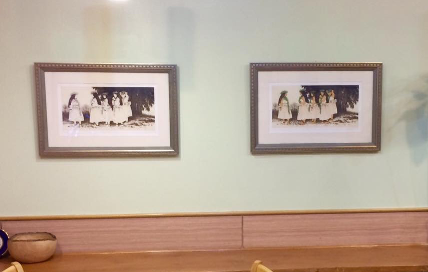 """I noticed two of my HULA SISTERS dry point engravings were hanging inside """"Ireh"""", a Korean restaurant in Honolulu, Hawaii. The print on the right is handpainted with watercolor and on the left, the only color is the sepia color etching ink. This is the first time I've seen two of my prints hung side-by-side; one with watercolor, one without."""
