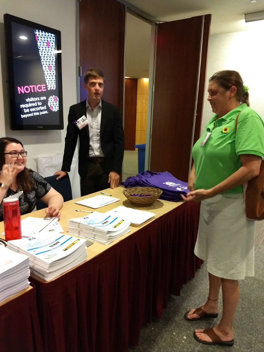 Melissa Anderson (right), Office Manager of Companion Home Care Inc, checks in at World Elder Abuse Awareness Day Fourth Global Summit in Washington, DC