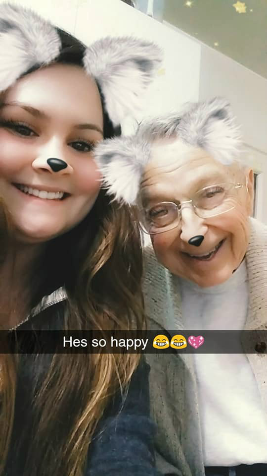 Caregiver Paris Small of Companion Home Care and client Charlie Lemon playing with Snapchat filters in Roanoke, VA