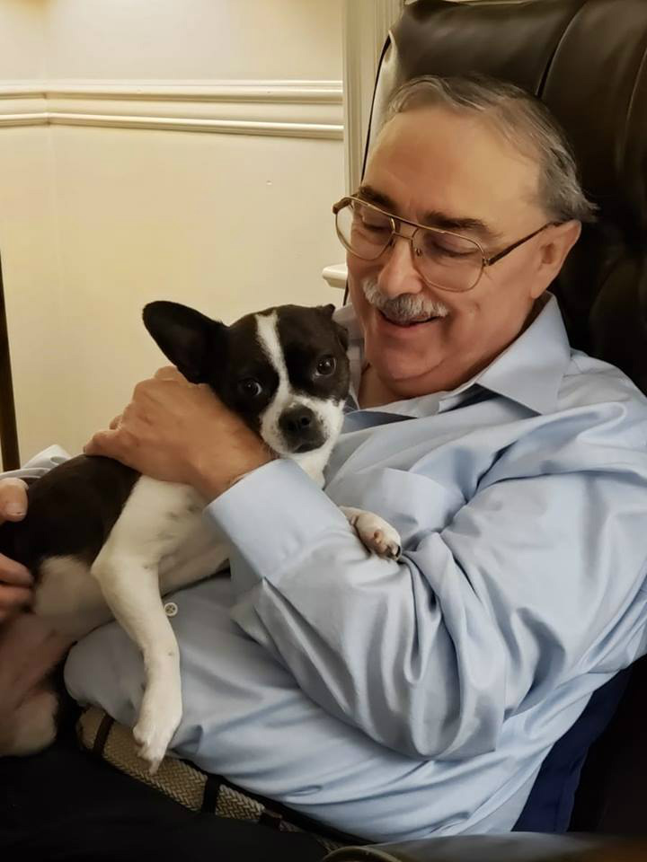 Companion Home Care client Chris Lemon getting a visit from his caregiver Heather Hodges and her puppy Ofelia in Roanoke, VA