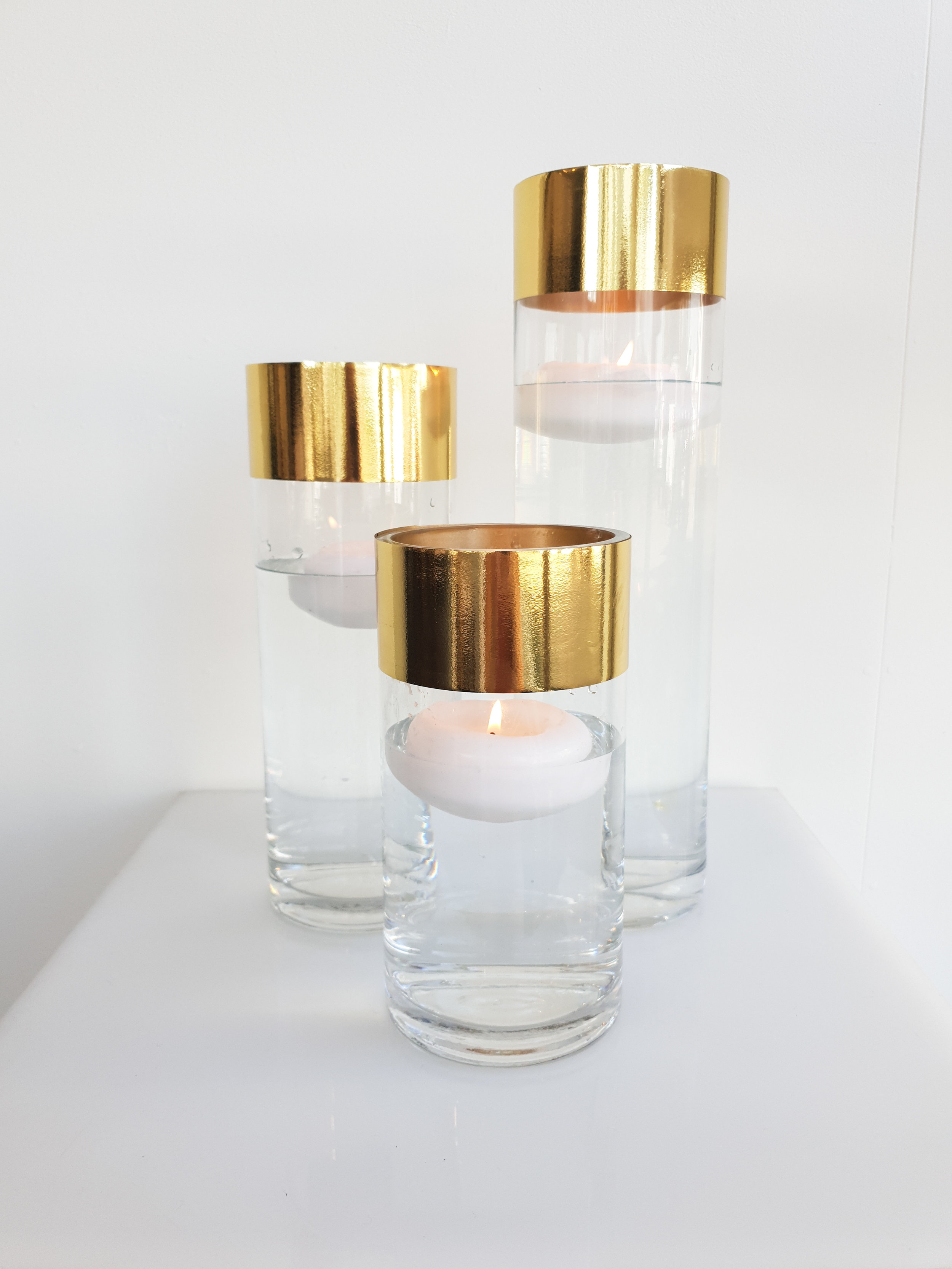 GOLD EDGE GLASS CYLINDER VASE WITH FLOATING CANDLE 20 CM H $8+GST 25 CM H $8+GST 30 CM H $10+GST 40 CM H $12+GST